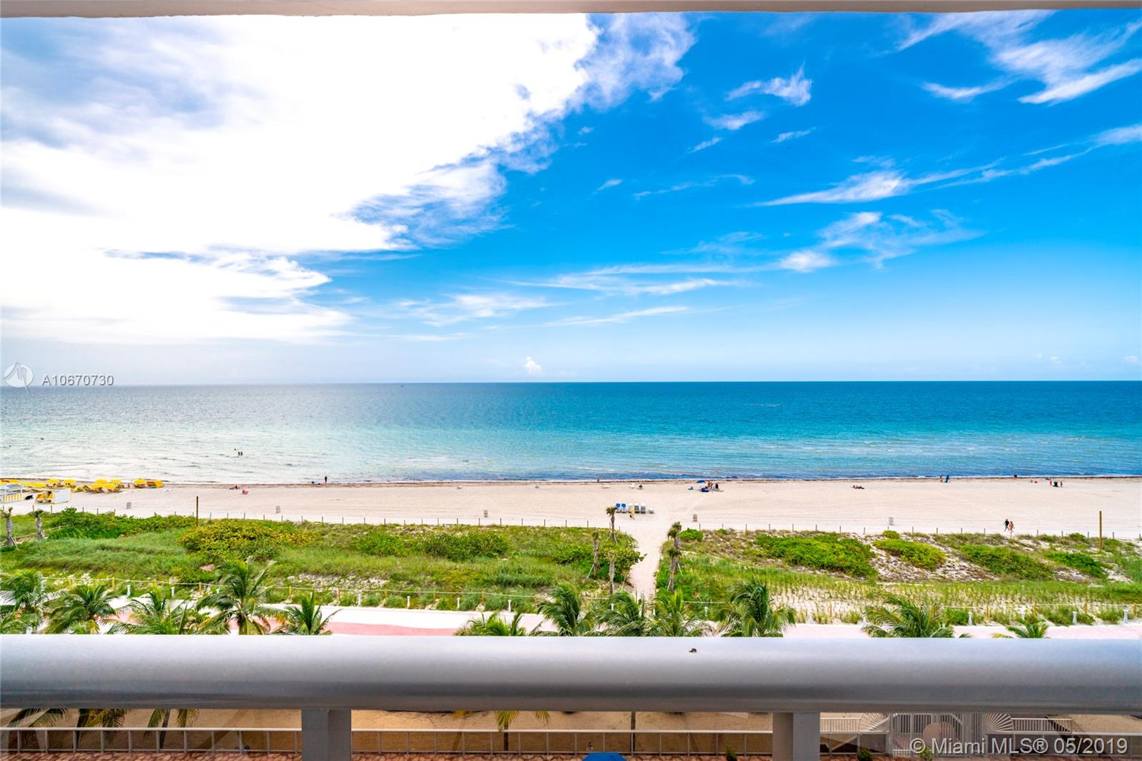Enjoy unobstructed, direct east facing ocean views!  Step onto your 40 ft long balcony through massive sliding doors from both living room and master bedroom.  Hurricane impact windows and sliding doors throughout the entire unit.  Huge master bedroom suite, large 2nd bedroom, and an additional enclosed room that can be used as a 3rd bedroom, den, office, utility room, study, or storage. Current owner FULLY renovated the unit by opening up the kitchen to create an open floor plan, new tile floors, custom kitchen cabinets, new appliances, washer and dryer in unit, recessed designed ceiling with additional lights, and much more! Storage Room, BBQ Tiki Huts, Children's Playground, Heated Pool, Gym with Sauna, Library, Game Rooms, Covered Parking, 24/7 Valet, Security. Direct beach access.