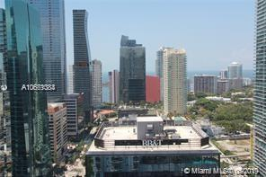Brickell life style at your doorstep.. Beautiful 2 bedroom - 2 full bath condo with 2 balconies. Wake up in your master bedroom with an amazing ocean view.  Living/kitchen area features marble tile and enjoy cherry wood floors in the bedrooms. Kitchen boasts granite counter tops and stainless appliances. Live in the heart of Brickell in this full service building with 24 hr attended lobby and valet. Fitness center, pool, hot tub, golf simulator, billiards room, and party room plus you are steps to all the restaurants and shopping. Pet friendly-  two pets 25lb max per each.  Offered Fully Furnished with full price offer.