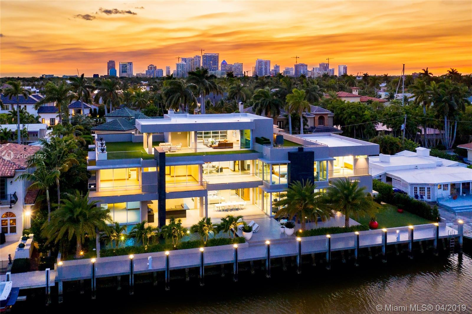 Sleek sophistication meets intelligent architecture in the prestigious Las Olas Isles. 3-Story design with over 9,000 sq ft of luxury and smart home technology including integrated sound system. Designed for an entertainer, this contemporary home offers 131 ft of water frontage with easy ocean access, a lap pool with built in spa and outdoor kitchen, a third floor club room with wet bar and stunning views from sunrise to sunset. 2 single arm car lifts, custom elevator, 3 gas fireplaces. 7 zone A/C and camera security system throughout the entire home. This modern masterpiece has 7 generous bedrooms and 9.5 bathrooms. Italian kitchen featuring Sub-Zero & Wolf appliances, steam shower with a sauna. Only the finest finishes throughout.