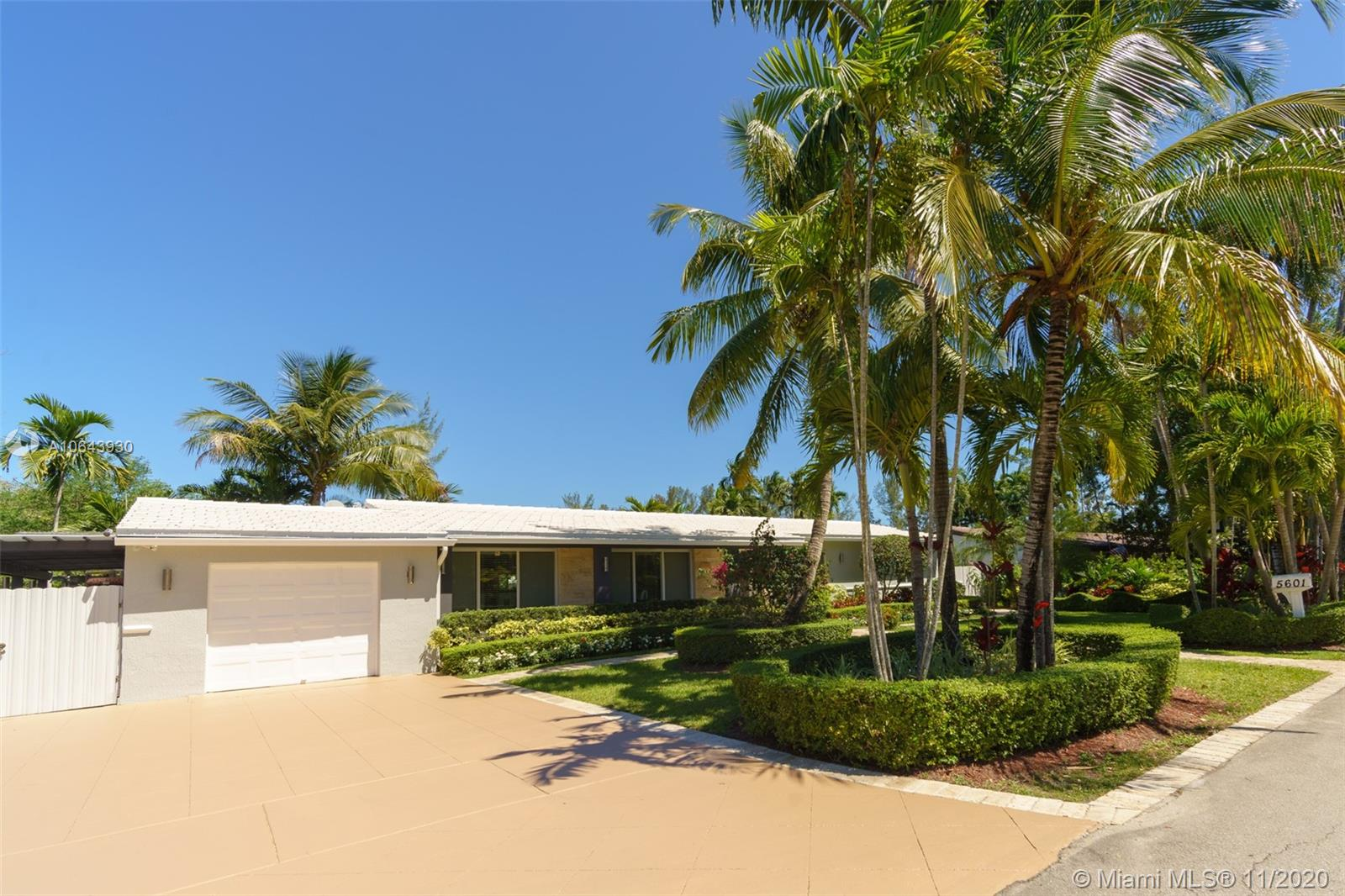 Come and fall in love with this completely remodeled dream home with 42 solar panels. This house has super bright 3/2 plus 1/1 cabana room with its closet and bathroom. Move-in ready with Italian marble floors, remodeled kitchen, updated bathrooms, impact windows and doors. You'll love the outside area that includes a covered dining area with a full kitchen and beautiful pool and view. Driveway with ample parking space, and one car garage attached.
