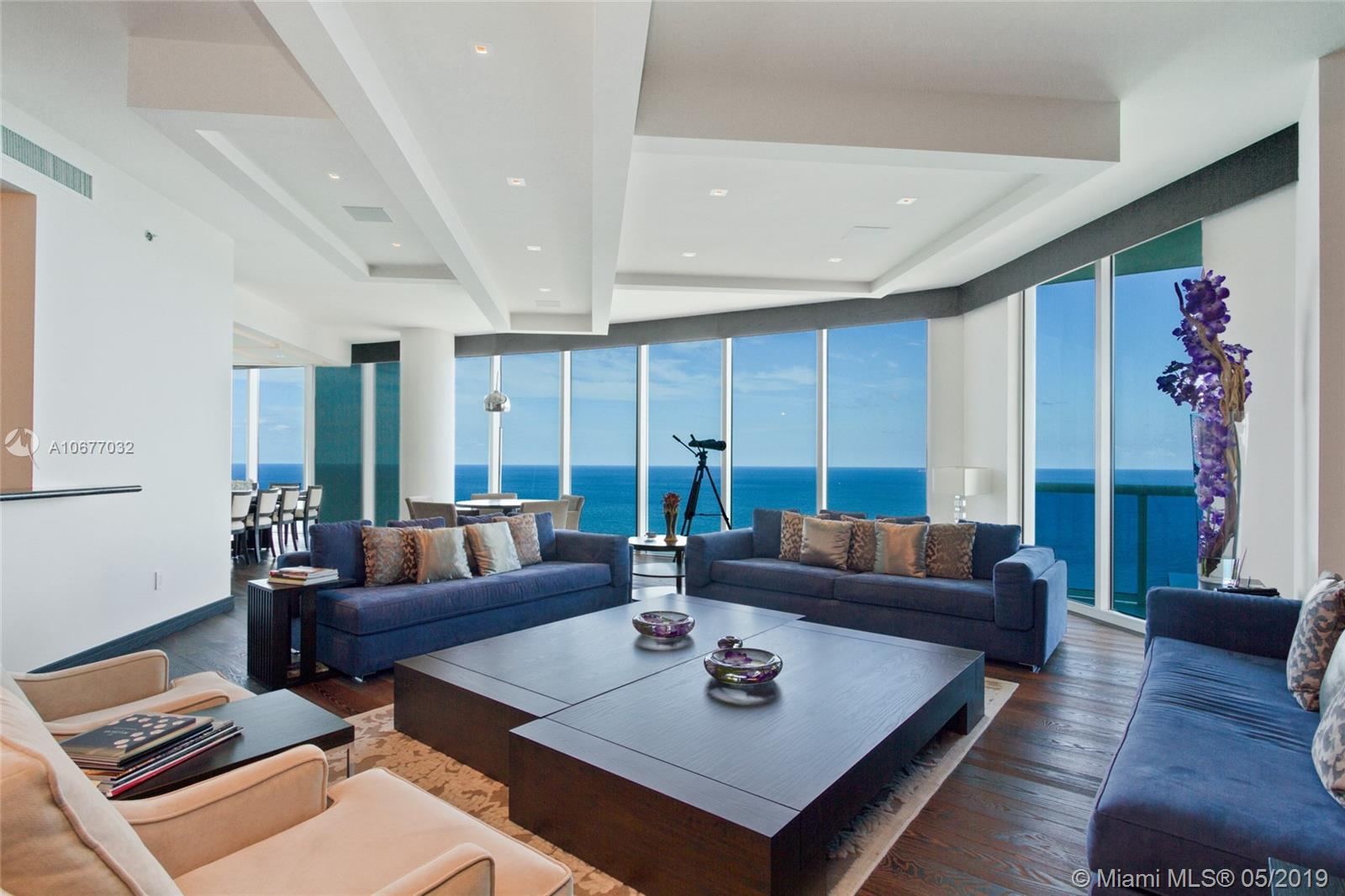Breathtaking oceanfront Sky Residence, South-East Corner unit. 5086 Sq.ft under A/C, 920 sq.ft private terraces. 5bd, 6.5 bths, plus library TV room living, dining area & gourmet kitchen. Settled on 270 feet of pristine white sand. Enjoy panoramic views of the Atlantic, Intracoastal and city skyline from 11'' floor-to-ceiling impact proof windows and wrap-around terraces. This Home is professionally decorated, the custom kitchen offers designer appliances, including temperature-controlled wine storage and a Miele espresso machine. Perfect for entertaining, this residence features an elegant dining room with spacious family room, all with ocean or Intracoastal views.