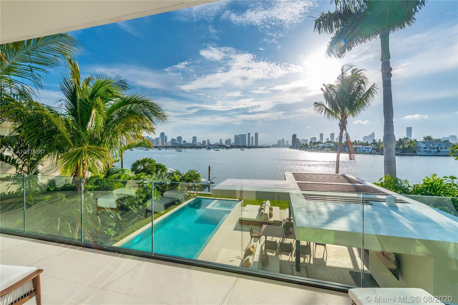 New Construction. Gorgeous 2-story contemporary waterfront home located on the Venetian Islands with incredible views of the Miami downtown skyline, open bay & the most dramatic sunsets in Miami affords an enviable luxury lifestyle in a prestigious, sought-after locale.