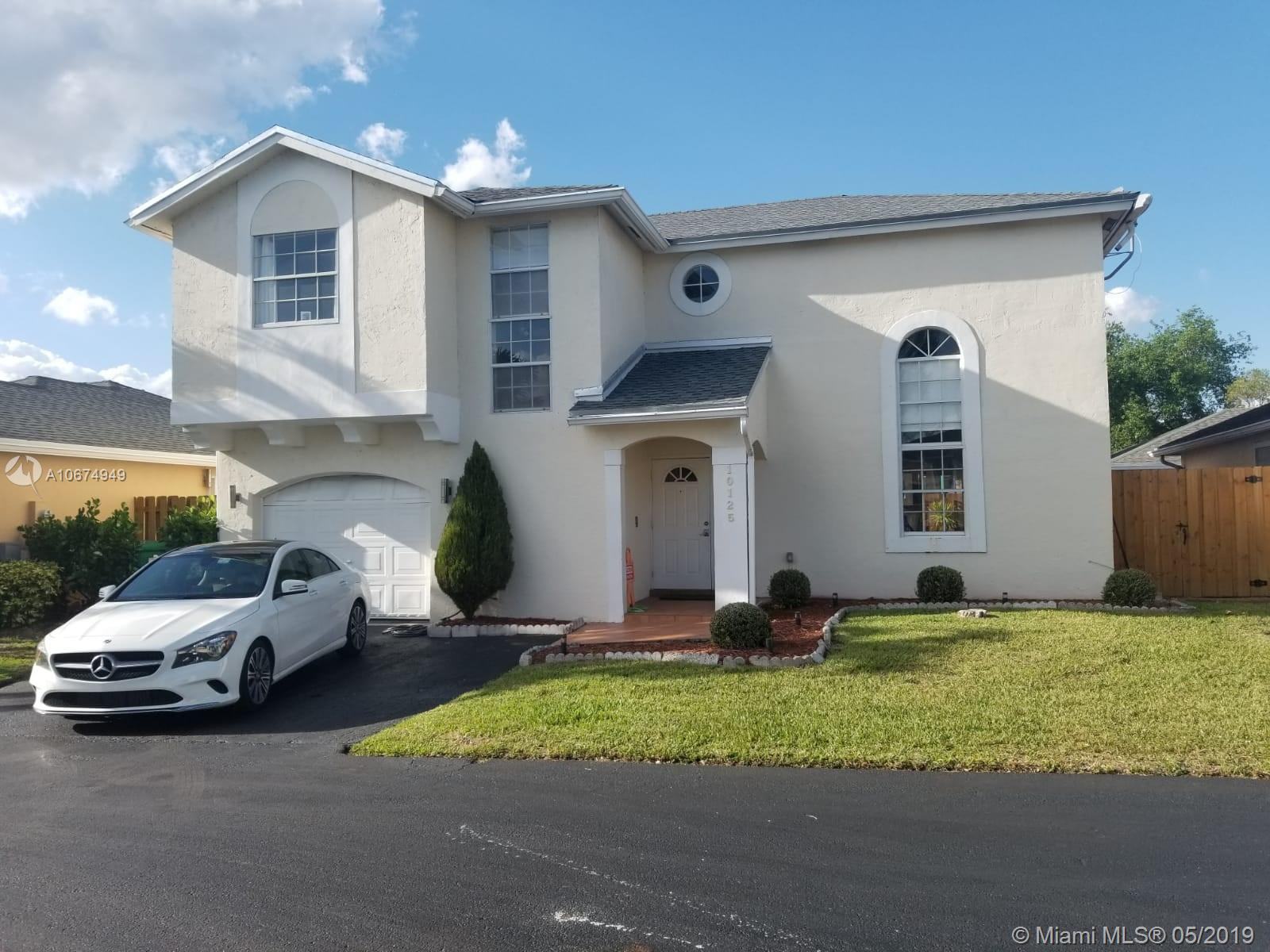 """BEAUTIFUL 2 STORY HOMES IN DORAL PINES,LOCATED WITHIN THE PRESTIGIOUS DORAL PARK COMMUNITY WHICH OFFERS MANY AMENITIES,INCLUDING POOL,OUTSTANDING GYM AND SAUNA,KIDS PLAY AND AMAZING TENNIS AND GOLF CLUB.THE HOUSE HAS BEEN RECENTLY UPGRADE WITH HOOD KITCHEN CABINETS AND GRANITE COUNTER TOP. IT IS REALLY A WELL KEPT GEM. """" A """" RATED SCHOOLS, CENTRALLY LOCATED AND CLOSE TO DOLPHIN AND INTERNATIONAL MALL AND MOST IMPORTANT EXPRESSWAY.IF YOU SEE IT YOU WILL LOVE ."""