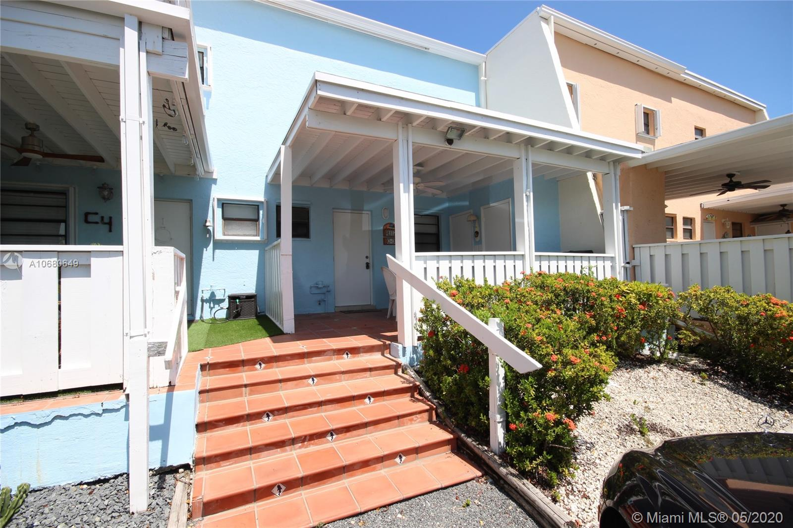 GREAT LOCATION! Very well maintained, two level townhouse unit with 2 bedrooms & 2 bathrooms. This unit has a front large covered porch, storage, a screen porch off the living area and another screened area upstairs. New Roofs recently installed as well as paint. This unit is right by the lagoon, pool and chickee hut / BBQ area. Kids have a playground area... tennis, beach and a boat ramp with slips available for rent. Come enjoy resort amenities!
