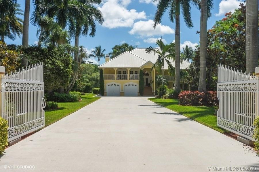 Extraordinary, landmark home located in the exclusive BBB Ranches of Parkland. Key West style, privately gated, main house offers 6 bedrooms, 4 bathrooms & 5 balconies/porches. Resort style waterfall pool/hot tub perfect for entertaining. Gourmet kitchen offers newer SS appliances. Bathrooms have been tastefully remodeled. Wood burning fireplace in huge family room. This unique property also offers 700 sf RV garage, 1008 sf office with 1/2 bath, 1872 sf workshop with 1/2 bath, large lake w/ lit fountain & lush landscape. Property adjacent, 4.5 acres is a fully equipped nursery w/pumps, shade house, has an agricultural exemption & can easily be converted to equestrian use. Can be purchased along with this spectacular property for a total of 9 sprawling acres.   Excellent schools.