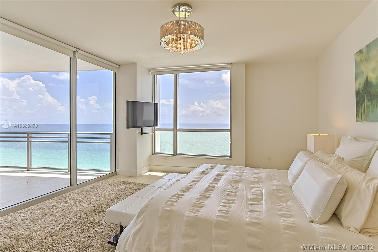 SPECTACULAR 3 BED ,3 1/2 BATH WITH DIRECT BEACH AND OCEANFRONT VIEWS! SPACIOUS, 3050 SQ.FT, LIGHT AND BRIGHT, SPLIT FLOOR PLAN W/PRIVATE ELEVATOR AND PRIVATE LOBBY. IMPECCABLE AND DESIGNER FINISHED WITH MARBLE FLOORS, RECESSED LIGHTS, OPEN KITCHEN, CUSTOM WALK-IN CLOSETS, 2 LARGE BALCONIES, PRIVATE SURROUND-SOUND THEATER ,FITNESS CENTER, ENTERTAINMENT AREA, HEATED SALINE POOL & SPA. DELIGHT YOURSELF WITH THE WORLD CLASS SERVICES INCL.ROOM SERVICE AND MORE OF THE HILTON BEACH RESORT & SPA NEXT DOOR AND 8 RESTAURANTS.PURE LUXURY! EASY TO SHOW.