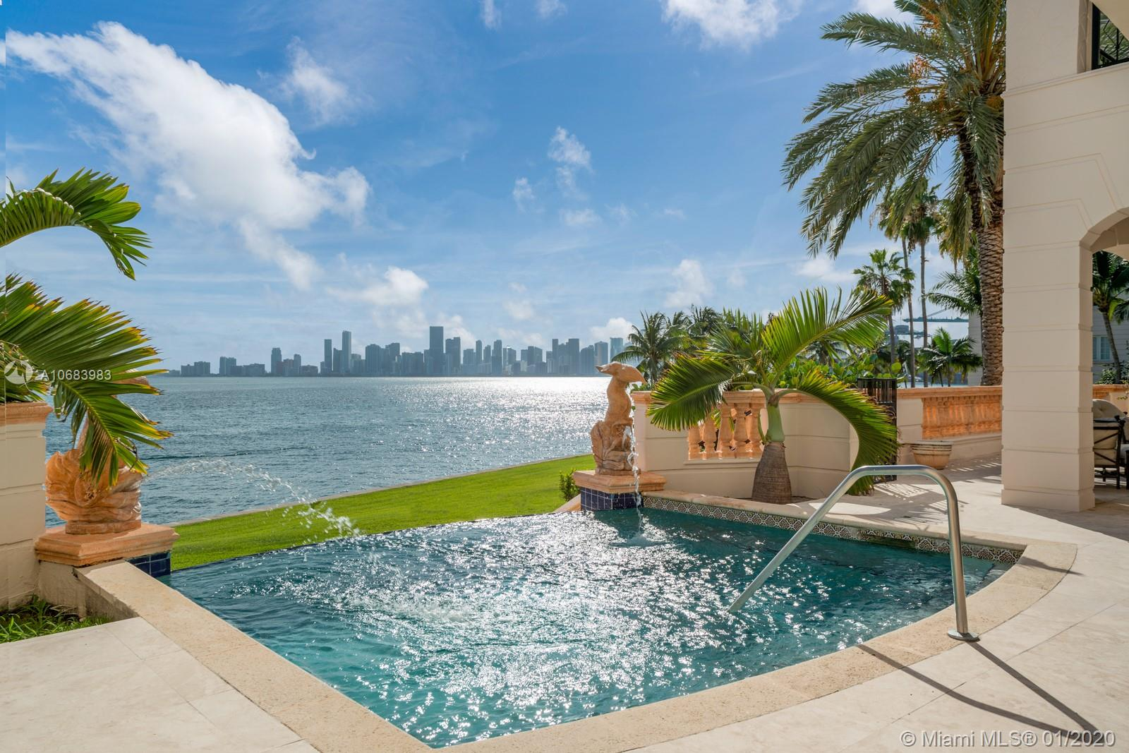 Exquisite bayfront villa on the exclusive Fisher Island, America's wealthiest zip code. This grand, 6-bedroom/ 7.5 bath stunner boasts 6,618sqft of luxury with an impressive 2,000sqft terrace overlooking Biscayne Bay and the Miami skyline. Custom interiors by world-renowned designer Steven G. Enjoy the majestic Miami sunsets from the expansive lanai featuring one of the islands only private infinity pools. Spacious living areas, well-appointed guest rooms, and a stunning master suite with attached office, huge walk-in closets, and beautiful his-and-hers master baths. Uniquely designed architecture with marble finishes throughout. Truly one of the most desirable residences available on Fisher Island.