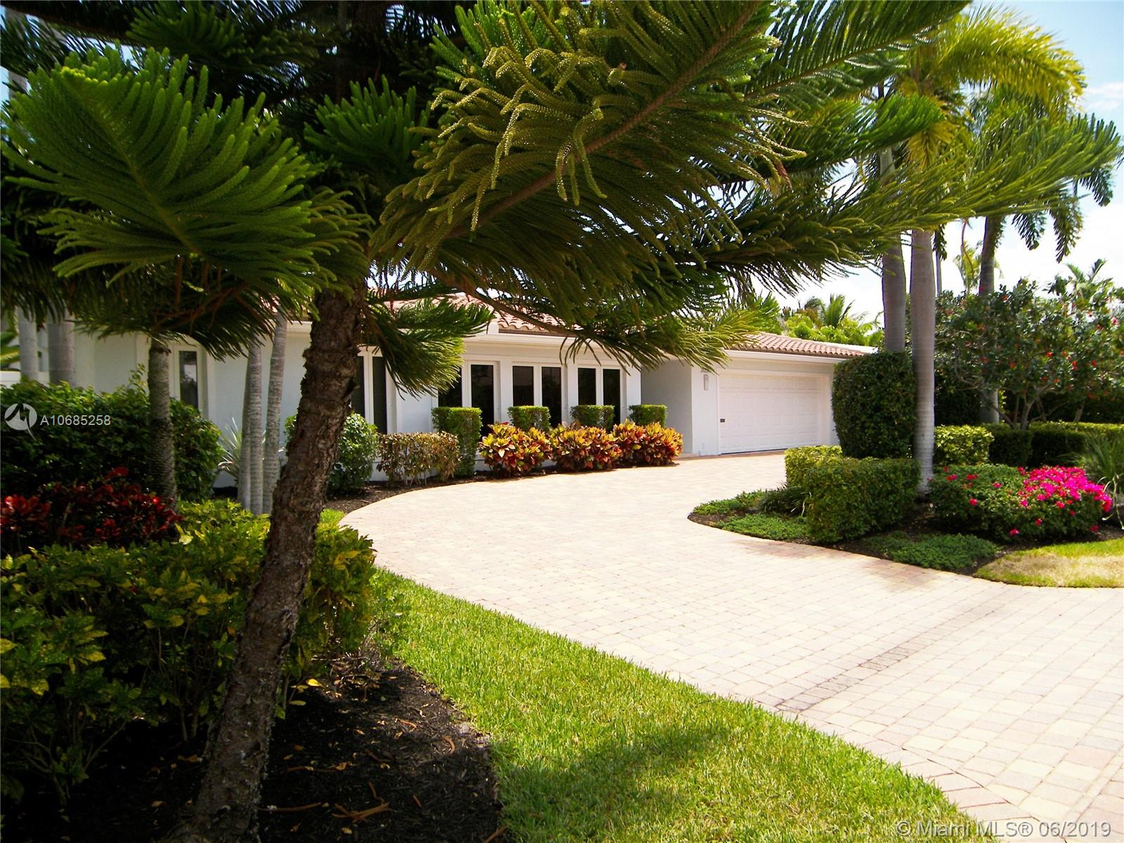 Amazing and unique contemporary waterfront masterpiece. Light and bright modern interior design: clean lines; Exquisite attention to detail at every turn of this 4 bed 3.5 bath plus office home. Chefs kitchen boasts Snaidero custom cabinetry, Miele appliances & quartz countertops. Large master suite features spa like bath with soaking tub, frameless shower & illuminating mirror. High ceilings in living areas.  Impact window & doors.  Backyard oasis has lush landscaping, large pool surrounded with marble pavers situated on 85 ft of waterfront with private dock;ocean access with no fixed bridges.  Walk or bike to Coral Ridge Yacht Club, Galleria Mall, Nice dining/shopping, or the Beach.