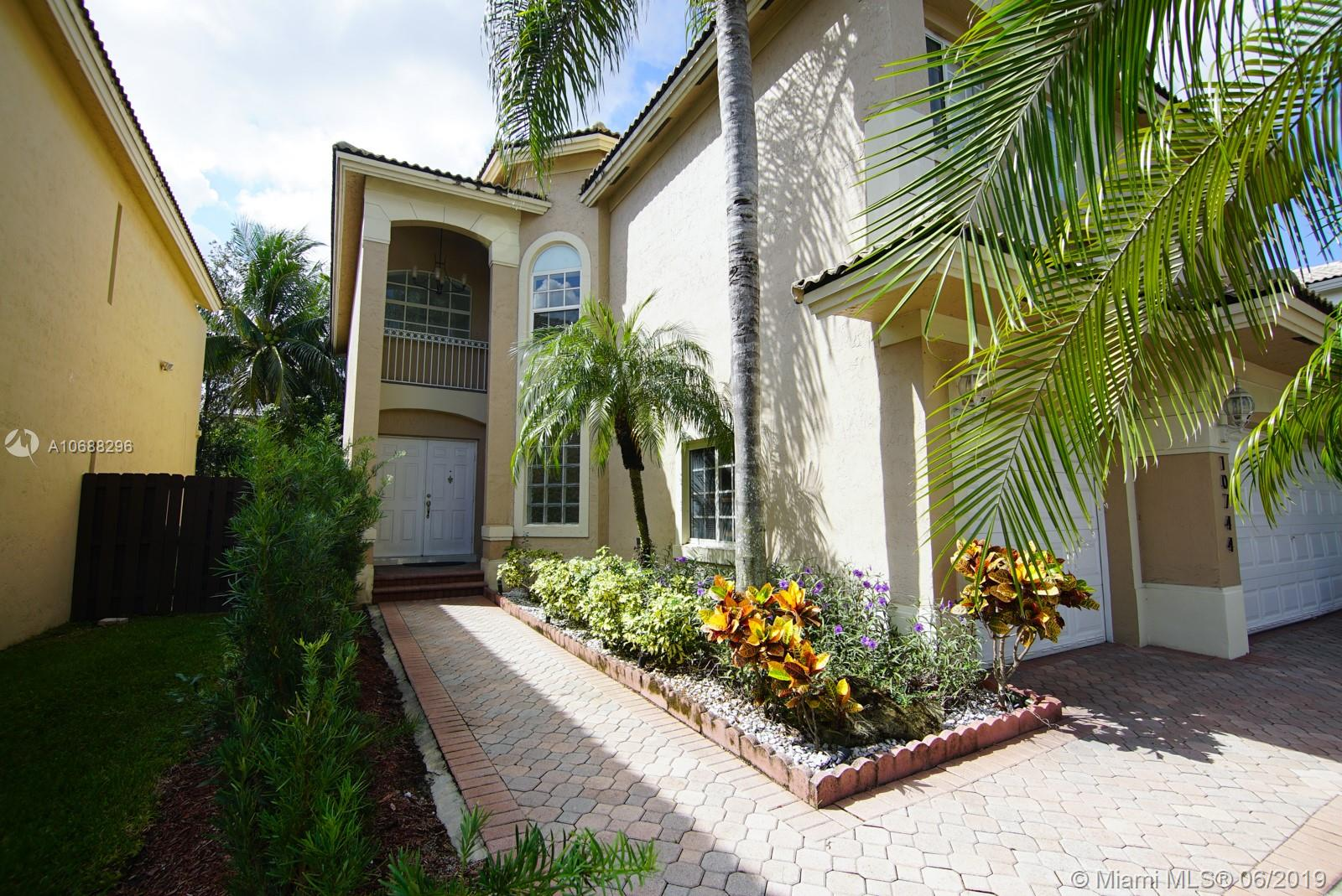 REDUCED FOR QUICK SALE!  SELLER SAYS BRING OFFERS! SELLER MOTIVATED! Now is the time to purchase & live in a resort type community in the middle of the best area of Doral. Spacious incredible home in St Croix completely remodeled ready to be occupied. this house was barely used as a second home. Very well maintained & updated. White porcelain floors all over, Modern sleek glass handrail takes you to ample second floor with 4 comfortable bedrooms. Generous great kitchen with top of the line appliances.family room with pool view&built-in entertainment center.One bedroom & bath downstairs, perfect for guests or in-laws. Large garage. Enjoy the great amenities of Dorl Community Club. Classes for adults & children plus many events sponsored by the community. Great schools