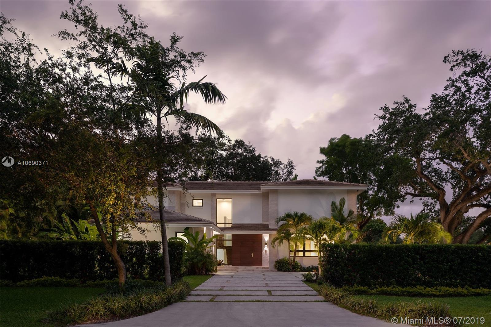 """Alongside Riviera Country Club and Golf Course in the """"city beautiful"""". This new two-story single family home combines a classic façade construction with a modern twist, open floor plans, high ceilings, sky lights; top of the line appliances, porcelanosa bathroom fixtures and a riza terrace in a tropical oasis."""