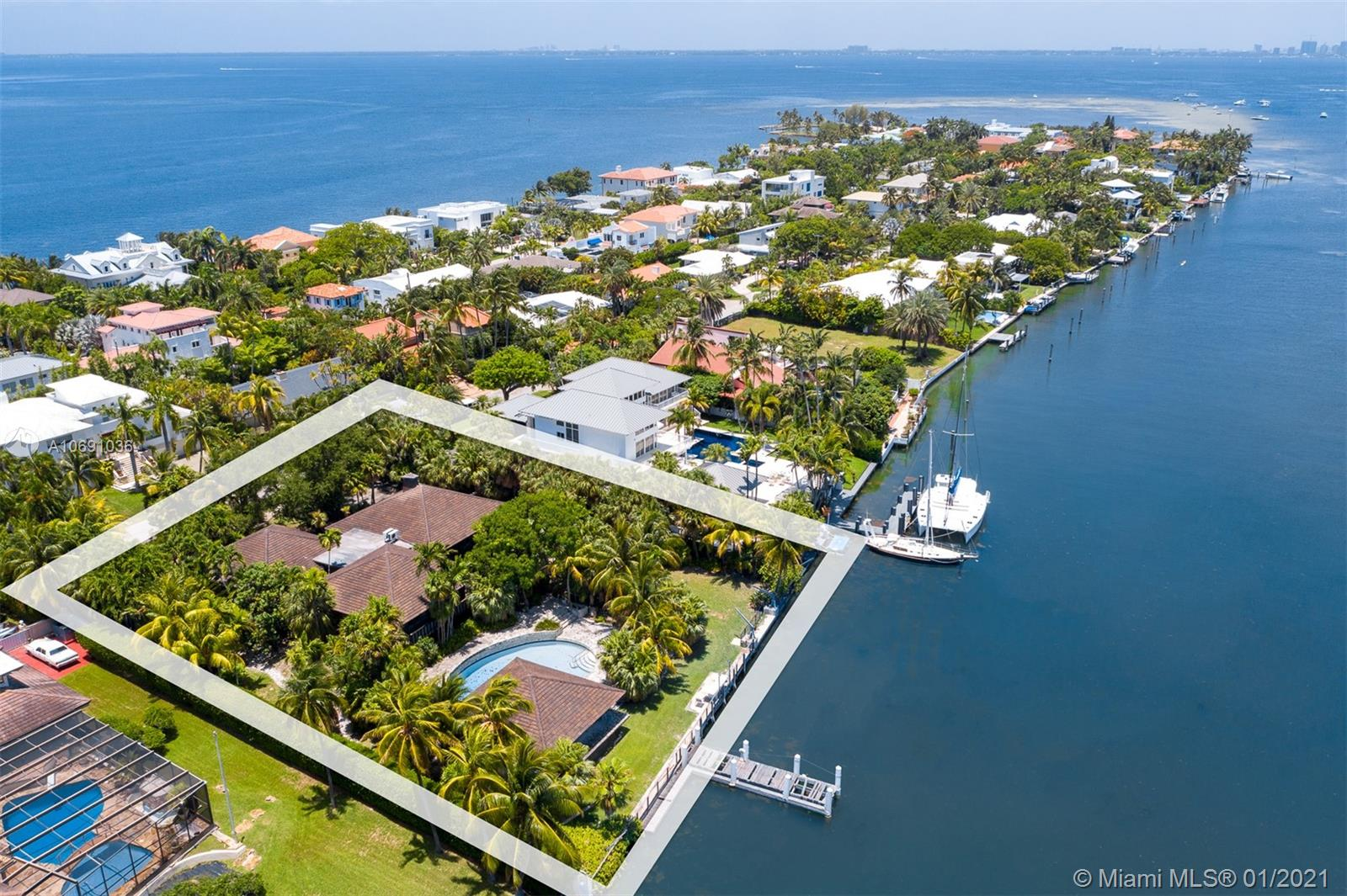 """Yachtsmans Paradise! Unique and rare opportunity to own one of the few remaining and most sought after double plus lots on private and wide bodied Hurricane Harbor. This oversized 31,996 sqft lot includes 152 linear ft seawall and a long dock jetting into the harbor. Ideal for multiple boat dockage and/or yacht. Unique custom built and """"over built"""" Polynesian style 4/3.5 pool home plus separate guest house. Home features Guyana Greenheart wood, teak, copper and coral rock. Ideal residence for entertaining with expansive coral rock patios and large pool with waterfall."""