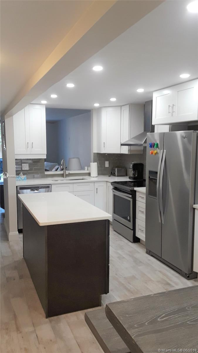 Completely renovated in 2018!!!   The features of this corner unit are endless.  Updates include restructured kitchen with quartz counter tops and stainless steel appliances, two tastefully remodeled bathrooms, tile floor throughout, upgraded electric,  hurricane impact windows,  newer A/C unit. Amenities include 24 hour manned security, heated pools, hot tub, function hall, courtesy bus, billiard room, card room, sauna, card room, etc. Community is close to beaches, shopping, dining, and golfing.Possible owner financing available!!!