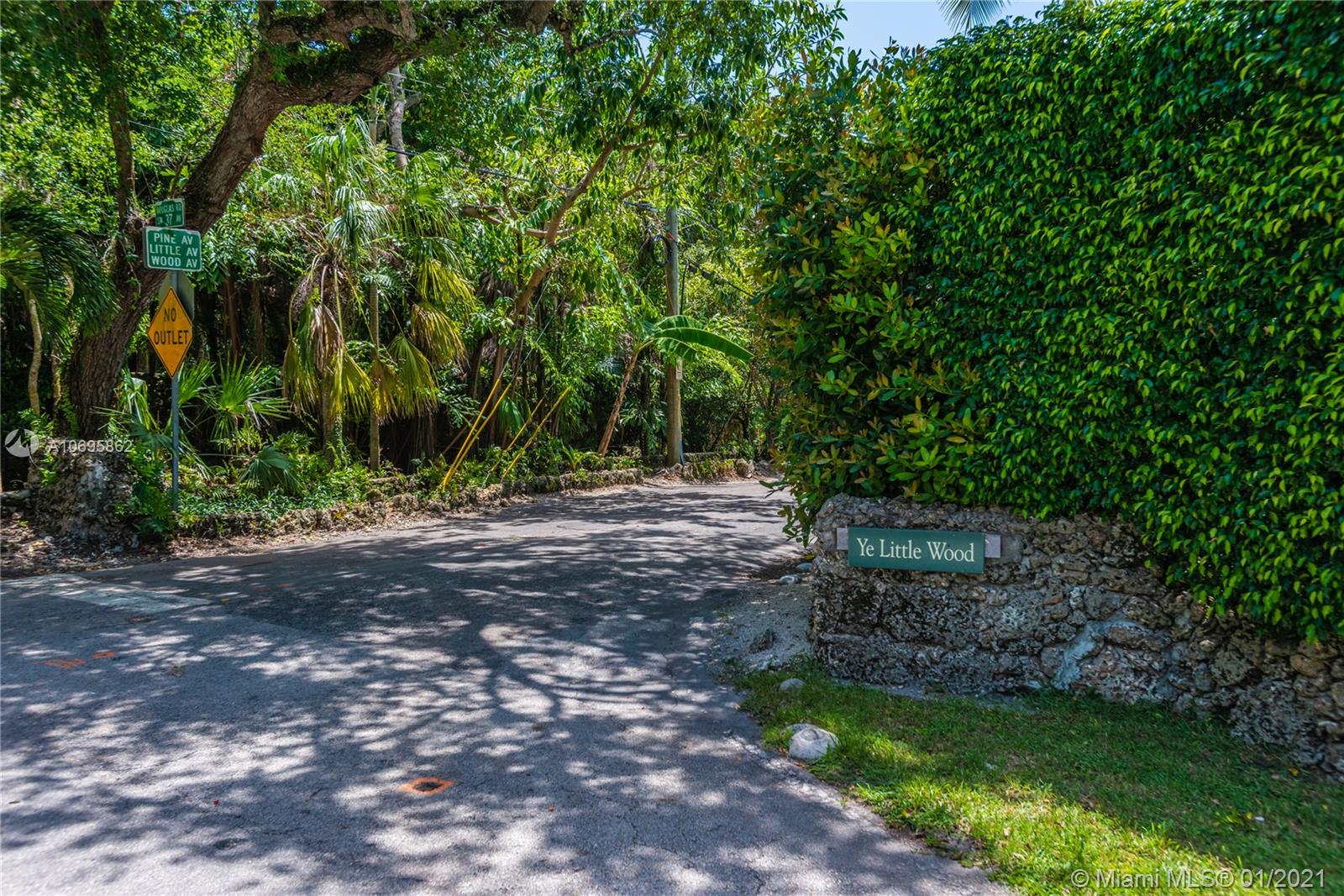 Spectacular High & Dry half acre tropical paradise in Ye Little Wood, South Coconut Grove's quintessential, private, gated enclave of 31 homes. Beautiful sited home has excellent floor plan with solid hardwd floors, open beamed ceilings, walls of windows, new roof and lots of natural light throughout. Lovely covered veranda and elegant center foyer entry, wide open formal living & family rooms, fireplace, formal dining room, butler's pantry and large eat-in kitchen. Huge covered terrace with terrazzo patio and summer kitchen provide living al fresco. Wide hallways access the Master BR suite, bath, dressing area, large closets +2 additional bedrooms & bath. 4th BR +separate bath are located off the kitchen, over-sized 2 car garage and utility areas. Plenty of room for pool and expansion.