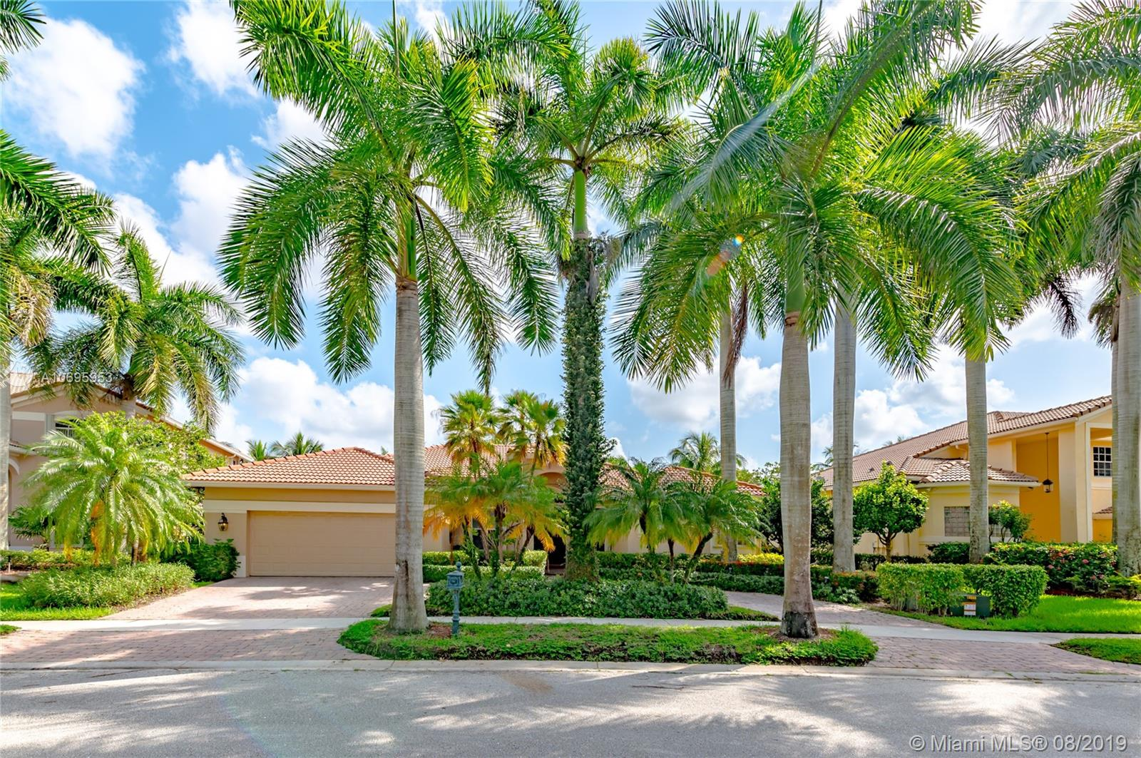 Enjoy this beautiful home in one of the best communities in the city of Weston, Weston Hills.  Home features 5 bedrooms, 3 full baths, 2 car garage. Neutral tile in all areas and neutral colors thruout the home. Great triple split floor plan with open kitchen and lots of room to entertain. Stainless steal appliances and granite countertops. Fully fenced patio with gorgeous pool area and gardens.  Accordion shutters. Short walk to playground. A+ Schools A Must See!!!