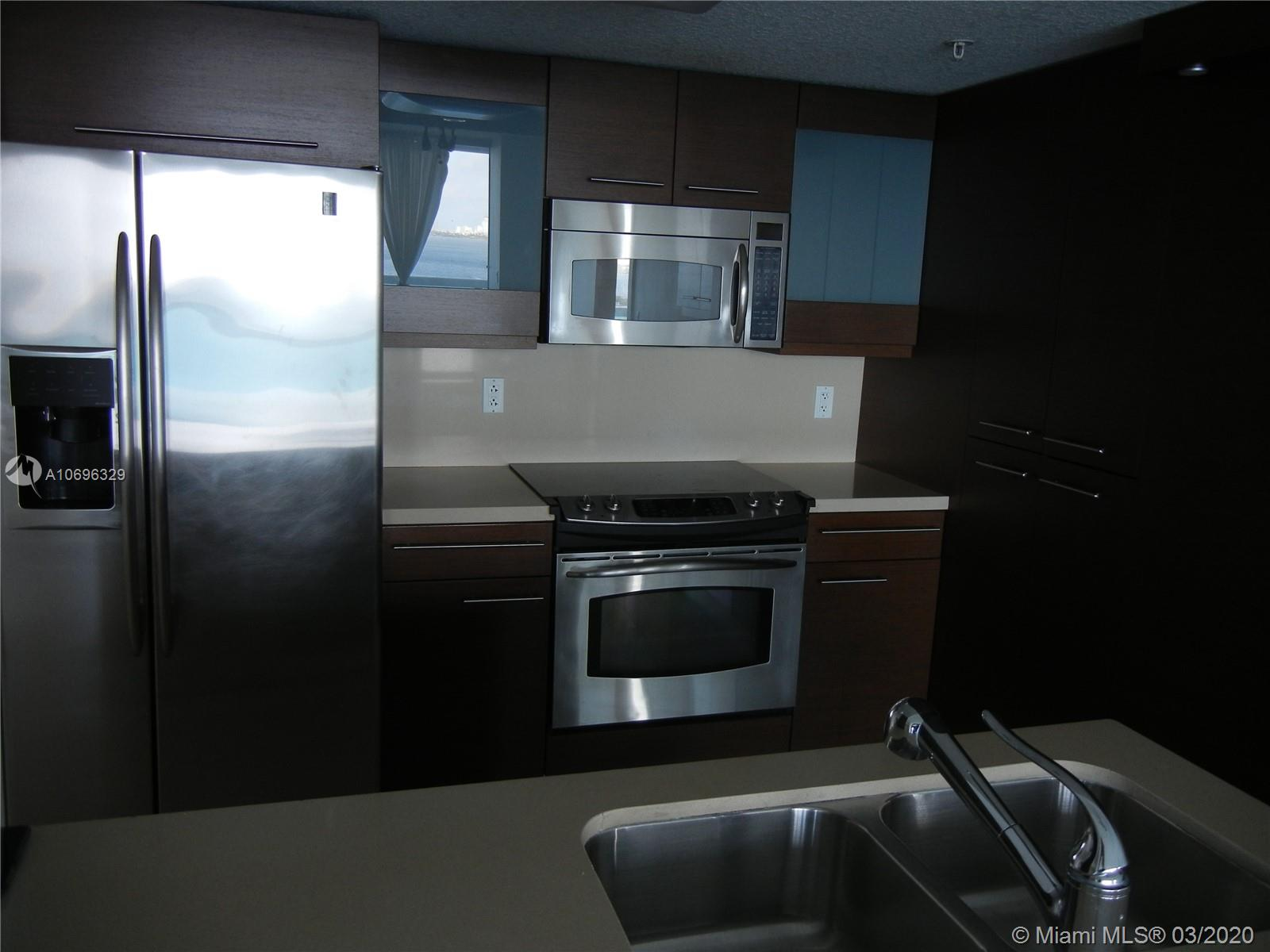 Just Reduced for a quick sale.  Enjoy amazing bay and park views from this 2 bedroom 2 bathroom corner split floor plan unit at the 1800 Club. Unit has many additional upgrades.  Open kitchen with dining island, built out closets, tile flooring throughout.  Master bedroom has an additional window for added light and north views. Terrace runs along the whole front of the unit overlooking the bay, Miami Beach, and the Margaret Pace park.  Building has many amenities: pool, gym, meeting rooms, security, attended lobby, valet parking. Convenient location right between 395 and 195 east of Biscayne Blvd, easy access to I-95, Miami Beach and Midtown. Walk to supermarket, restaurants, and the Arsht center. Contact listing agent for showing instructions.