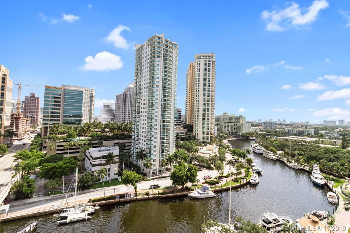 Stunning downtown Fort Lauderdale river and city views from this large 3 bedroom corner unit! Each room is spacious with lots of closets and a separate laundry room. Electronic blinds in livingroom and all lighting stays. Come live the NuRiver lifestyle which includes a large rooftop pool with views that go for miles. Enjoy a fully equipped 2 story fitness center plus basketball and separate handball courts. There is a cycle room, hot tub, saunas and a meditation garden. Business center, club room, bicycle storage and library round out the amenities. The front desk handles your packages and there is a dry cleaning service for the building. Truly a luxury lifestyle. Pets welcome and valet parking for second vehicle.