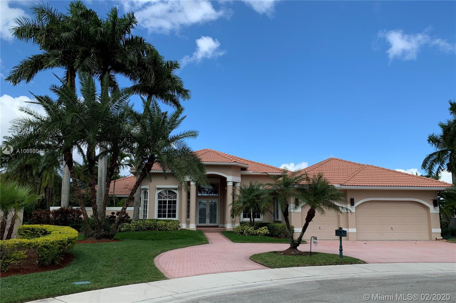 One of the most MAGNIFICENT VIEWS IN WESTON, in the PRESTIGIOUS WESTON HILLS COUNTRY CLUB. HUGE OVERSIZE LOT with 27,000 sq ft and 180-DEGREE BREATHTAKING LAKE AND GOLF VIEWS. Located in a CUL-DE-SAC in the premier section of Poinciana. Live the perfect lifestyle in this spectacular home, with an open concept floorplan and very high ceilings. Windows in every room allows for beautiful natural light and gorgeous views throughout the home. Very tranquil and private outside area, with a huge screened pool/patio enclosure. Master suite with spacious custom closets and a special feature: His and Hers master bathrooms. Circular driveway. Accordion shutters. Access to excellent A-RATED PUBLIC SCHOOLS. RENDERINGS WITH PROPOSED DESIGN INCLUDED. THIS PROPERTY IS UNIQUE AND A MUST SEE!