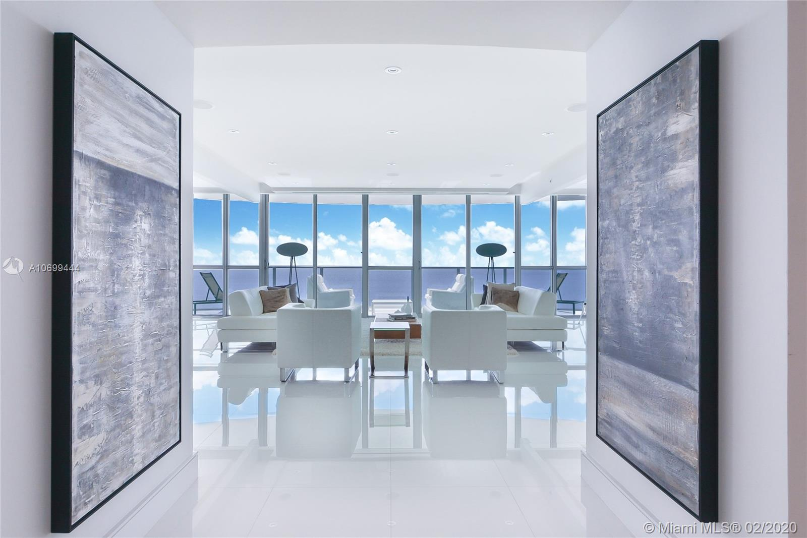 HOLLYWOOD GEM, OCEAN PALMS LUXURY CONDOMINIUM. By far the most compelling 3BR converted to 4BR floor plan in the area. Private elevator leads into a VERY EXCLUSIVE BRIGHT, OCEAN FACING UNIT. This breathtaking 08 line property provides SPECTACULAR VIEWS from the 10th floor where panoramic ocean and beach vistas display the best Hollywood has to offer. This gorgeous, sleek and modern apartment features white glass floors, modern tiled bathrooms, an ultra-luxurious wine room, custom closets, kitchen w/ Miele & Sub-Zero appliances, surround sound system, alarm & more. Professionally decorated. Wide-open 3091SF floor plan. Outdoor nirvana with over 500SF of entertainment deck for year round sunbathing & outdoor dining. 2 dedicated parking spaces!!!! Furniture for sale!