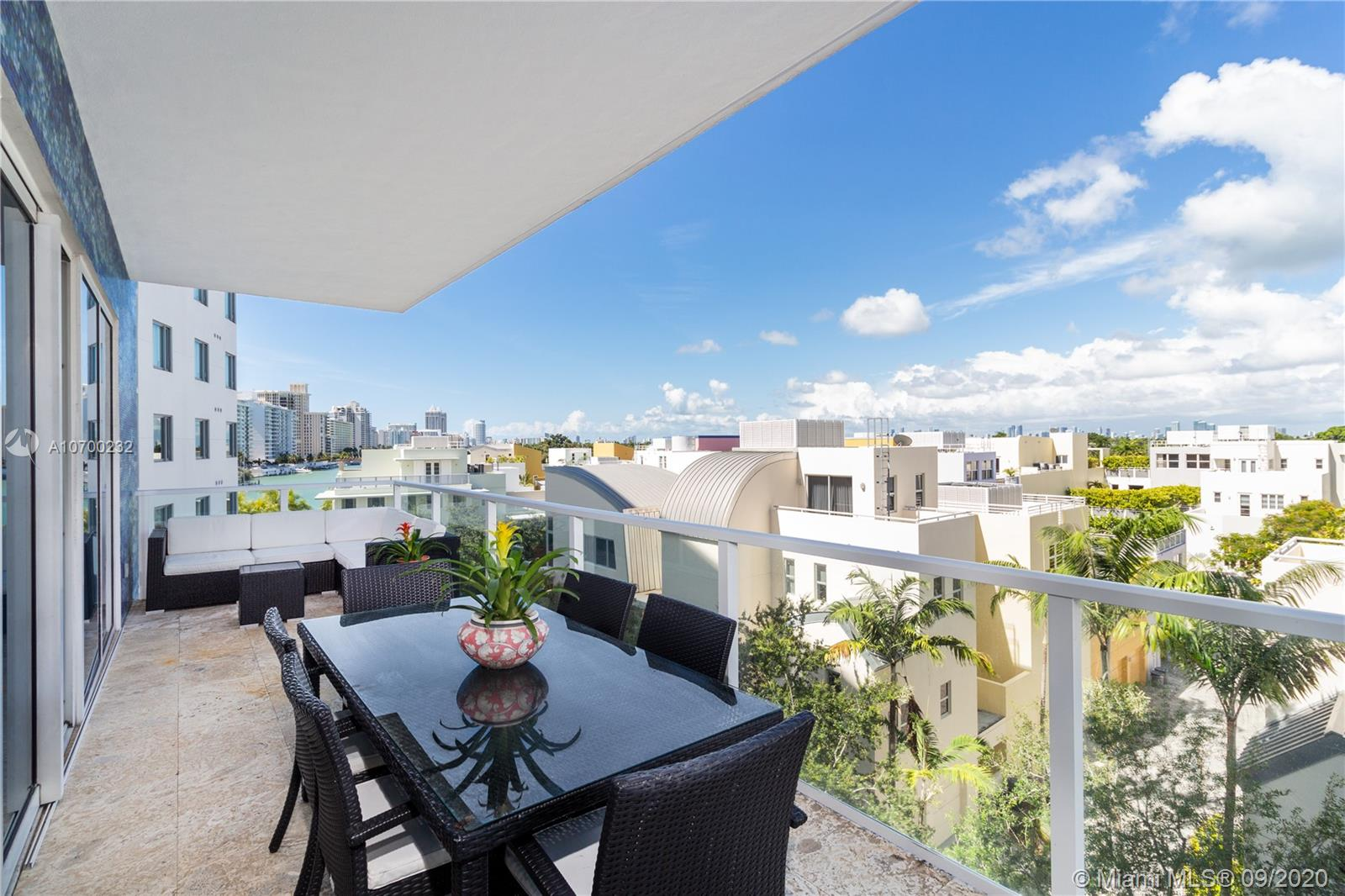 REDUCED $35,000 FOR QUICK SALE! MOTIVATED SELLERS!LIVE ON THE MOST PEACEFUL ISLAND ON MIAMI BEACHSTUNNING 2 BEDROOM 2.5 BATHHROM APARTMENT AT SPEAR AT ALLISON ISLAND, A PRIVATE GATED COMMUNITY ON 8.5 ACRES THE APARTMENT 1,755 SQ FT OF LIVING SPACE, BLONDE WOOD FLOORING, , KITCHEN W/MIELE, GAGGENAU, THERMADOR & SUB ZERO APPLIANCES. WATERWORKS SPA, DORNBRACHT FIXTURES ROOMS OPEN TO SPACIOUS BALCONIES WITH VIEWS OF INDIAN CREEK WATERWAY & MIAMI SKYLINE. ELECTRIC BLINDS, IN LIVING ROOM, CLOSET BUILT INS & SHELVES, IMPACT WINDOWS, 2 ASSIGNED PARKING. 2 INCREDIBLE 85 FT LAP POOLS, 6000 SQ FT STATE OF THE ART GYM W/MASSAGE ROOMS, SAUNA & STEAM AND CHILD'S PLAY AREA.