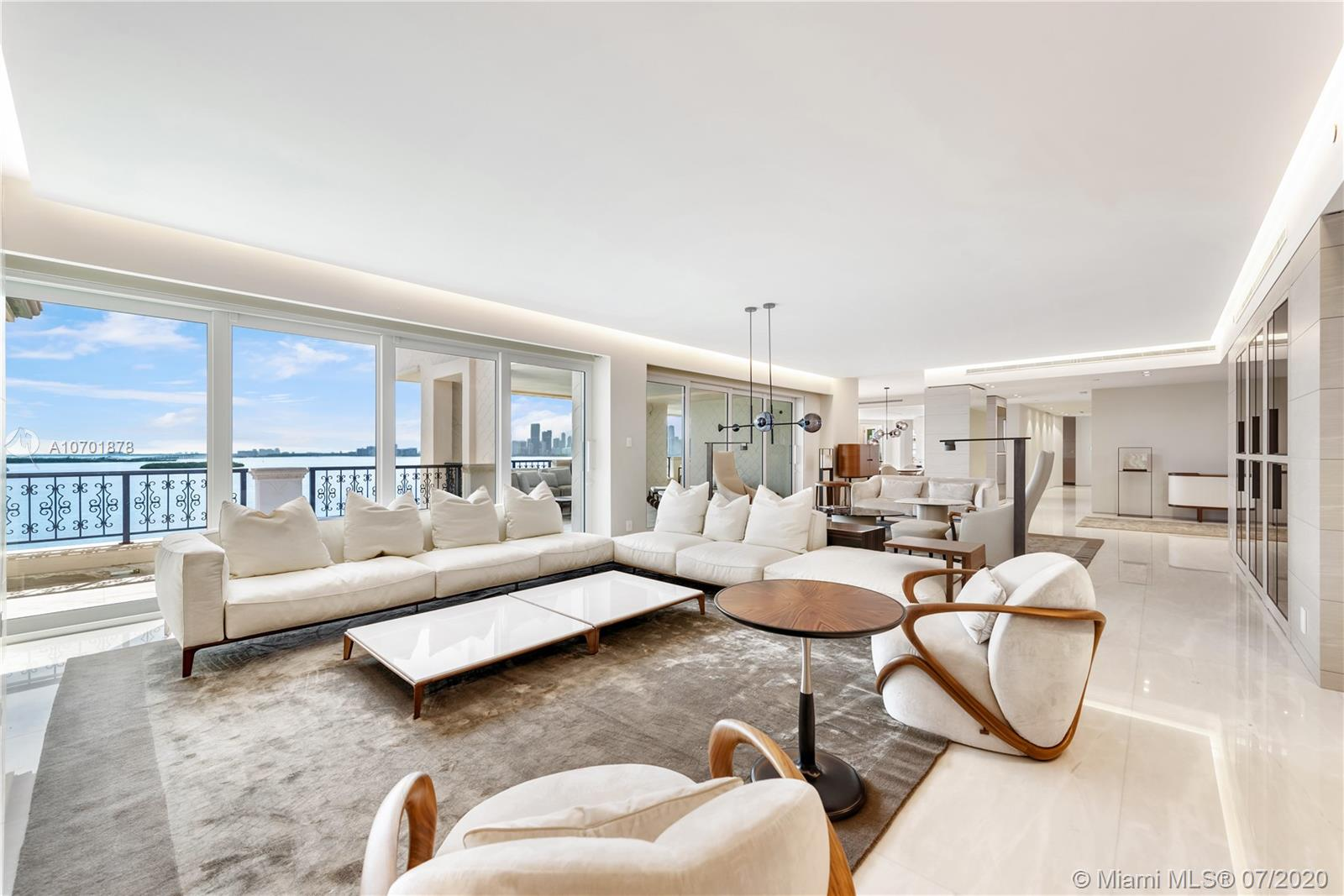 Complete spectacular renovation finished the end of 2019. This beautiful Bayview lower PH is the first unit in the US to be totally designed & furnished A-Z by Giorgetti. 6BR/7+1BA (Incl. separate staff BR) & over 2,000 SF of terraces with Miami Beach and sunrise views plus unobstructed Bay & Downtown Miami Skyline sunset views. Boasts Italian marble & oak floors in all bedrooms, open flowing living/dining area & family media room. Gourmet kitchen w/top of the line Miele appliances, center island & 4 wine chillers. Bay-facing principal suite with a large office & separate dual principal baths w/Turkish sauna, glass & onyx shower & voluminous walk-in closet. Smart home with new WinDoor motorized sliding doors & full replacement of AC & electric systems.