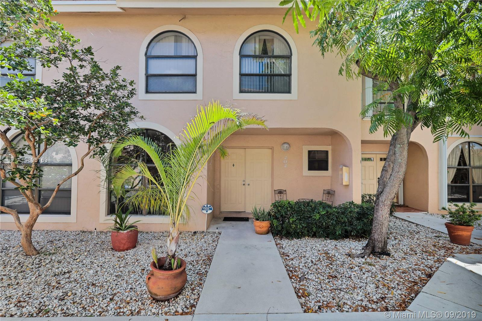 Enjoy the comfort of this hard to find, meticulously maintained 3BR/2.5BA town home showcasing a number of notable features including neutral tile flooring in the kitchen and baths, high end laminate floors throughout, as well as a bright, well-equipped kitchen with white cabinets and appliances, and tiled counter tops.  This home has plenty of natural light, with a wall of windows in the living room and dining room areas. Devoted to rest and relaxation, the 2nd level is home to 2 guest rooms, a upgraded full bath, and a Master Suite with vaulted ceiling, and beautiful master bath with white cabinets. Outdoors you'll find a lushly landscaped backyard with over-sized patio. Great community with low HOA dues. No assessments! Numerous shopping and dining options nearby.