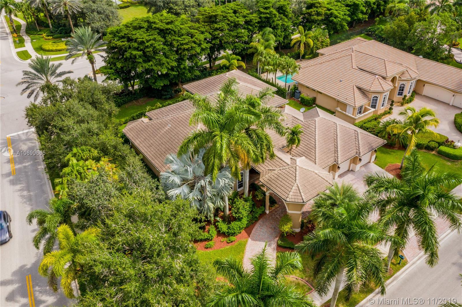 A TRUE WESTON TREASURE. CUSTOM BUILT BY ANTIQUE DEALER TO SHOWCASE GLOBAL TREASURES. GATED WESTON HILLS COUNTRY CLUB. PULL UP TO PAVERED PORTE-COCHERE OR PARK IN 1 OF 3 GARAGES. STEP DOWN FOYER ENTRY TO MARBLE FLOORS, CROWN MOLDING & COLUMNS IMPORTED FROM ITALY. 15,500+SF CORNER LOT, W/NEW LUSH LANDSCAPING THAT'LL MATURE TO TRU PRIVACY. 4BR/5.5BA/OFFICE HOME WITH 4300SF+SF & 12-16' CEILINGS. MAIN LIVING AREAS & KITCHEN JUST PAINTED WHITE.  MOTORIZED BLINDS BEING INSTALLED. CHEF'S KITCHEN- DBL OVEN/GAS RANGE & 250 GAL TANK & WALK-IN PANTRY. MASTER SUITE W/2 WALK-IN CLOSETS W/BUILT-INS, OFFICE/GYM AREA-HIS & HER BATHROOMS, JACUZZI, 2-ENTRY, MULTI-HEADS SHOWER, LAPIS GRANITE COUNTERS,VANITY AREA. 2ND MASTER OTHER SIDE. IN-LAW SUITE W/GARAGE ENTRY. WET BAR. 3AC/2H2O HEATERS.