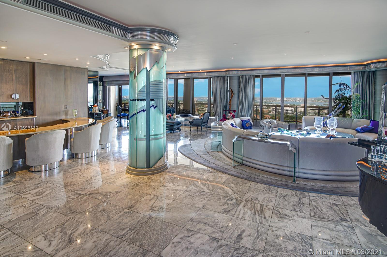 Private elevator leads you to one of the most unique Penthouses in Bal Harbour. Stretching over 5,883 living sq ft  & 7,310 total sq ft/ per appraiser, this sky residence is larger than other penthouses & features endless Biscayne Bay, Ocean & city skyline views.  Expansive wraparound terraces invite you to marvel at magnetic sunrises & sunsets. Grand foyer opens into a one of a kind spectacular living room w/ the bar & dining room created for entertaining large parties. It is followed by 2 guest bedrooms, 1 bedroom staff quarter, 5.5 baths, & a Royal size master suite w/ sitting area, his & her's baths & closets. Her closet galore features built- ins which will satisfy every fashionista. Bal Harbour Tower is a full service building w/ resort style amenities & renowned private restaurant.