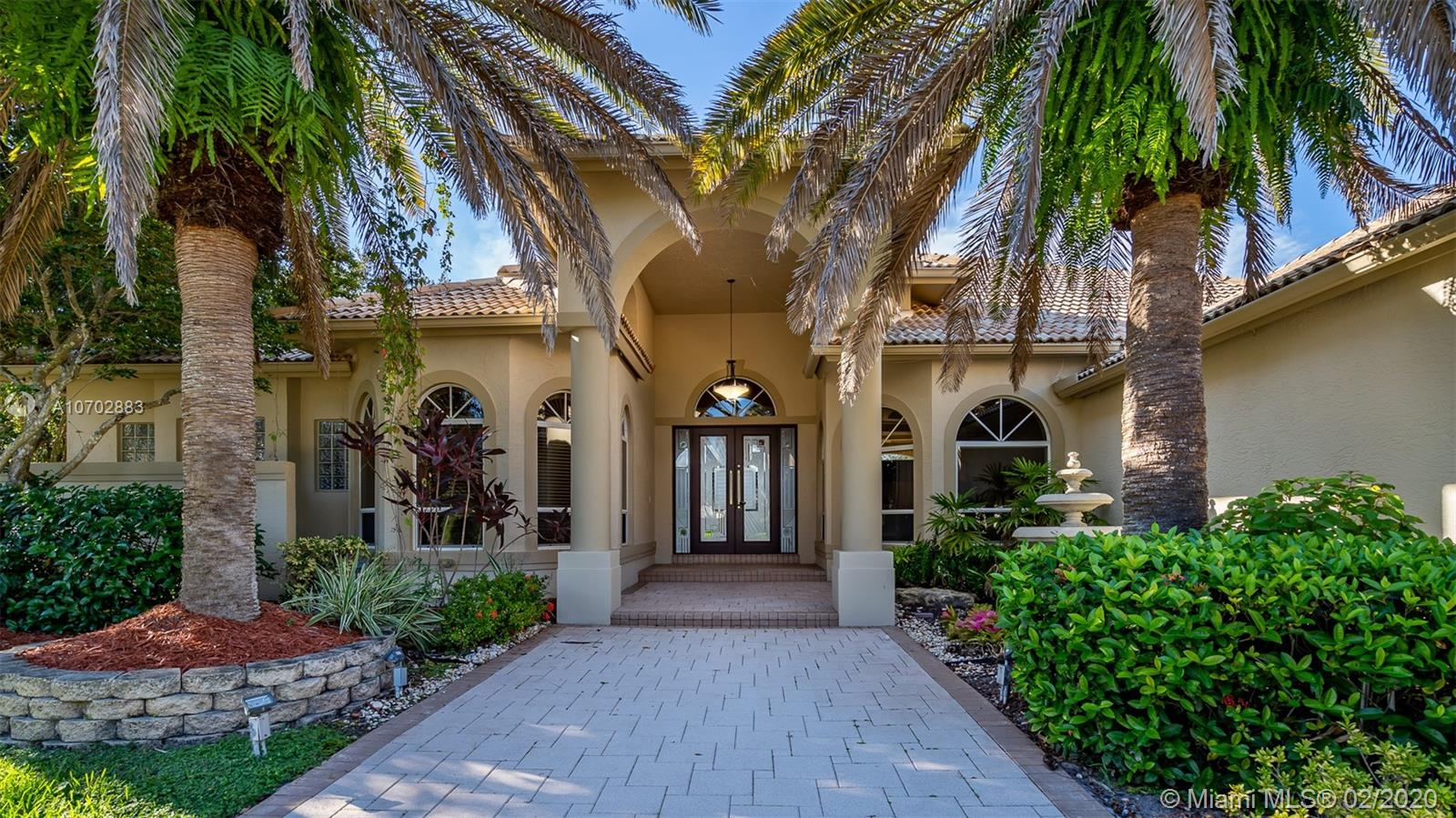 Taking back up offers. Beautifully updated in 2020. Fabulous lake front home in Pelican Landing .5 bedrooms plus office, 4 full,2 half bathrooms. Oversize en suite bedrooms,  and expansive  fenced lot with pool and spa. Spectacular sunset lake views. A must see.