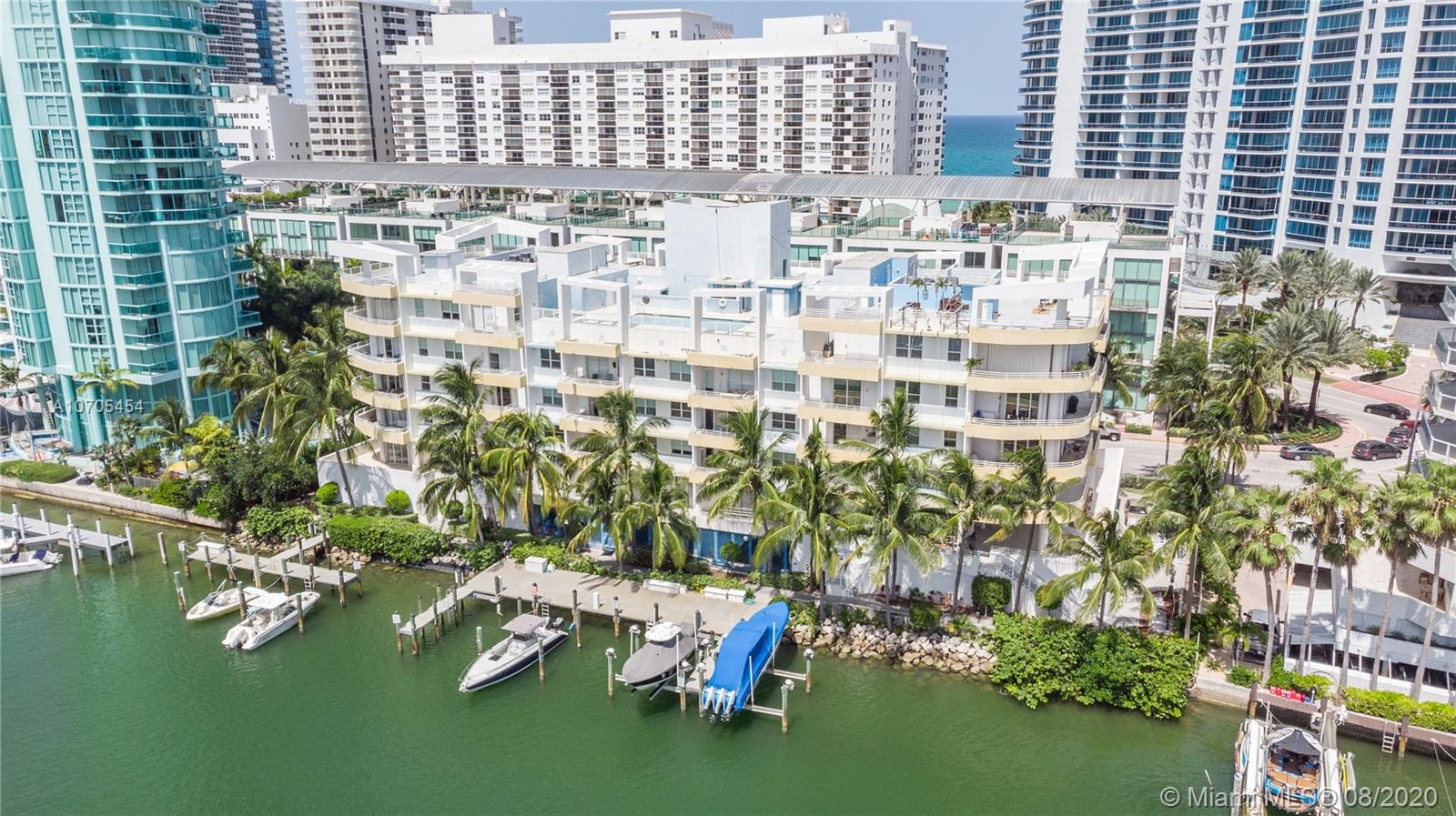 Exclusive Corner Lanai unit with wraparound terrace of almost 1000 sq ft, high ceilings, bright and spacious unit w hardwood floors. Feels as if you are directly on the water form this level, enjoy your spacious outdoor terrace with lots of room for outdoor furniture. Amazing water views from every room located in the desired Miami Beach district and a walk across the street to your publicbeaches. Boutique building with just 33 units. Fully amenities building w rooftop pool and gymnasium, sauna, steam room and 24 hr security w front desk atendee. Boat slips to the community available for docking your boat.