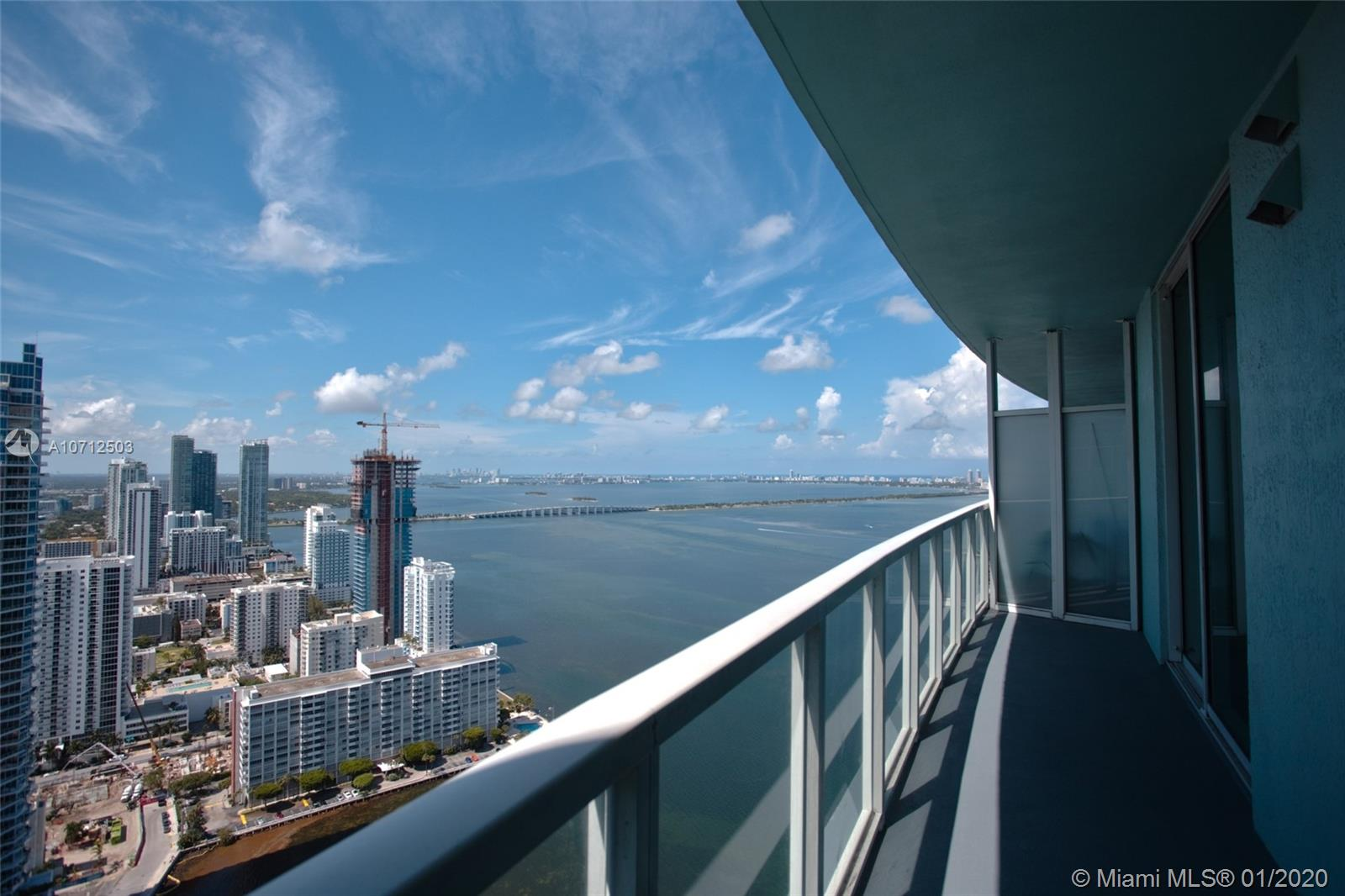 Spectacular open bay view from this gorgeous 1 bedroom plus den and 1 bath condo across from Margaret Pace Park. Enjoy walking to your favorite restaurants in the new Hip, Edgewater neighborhood