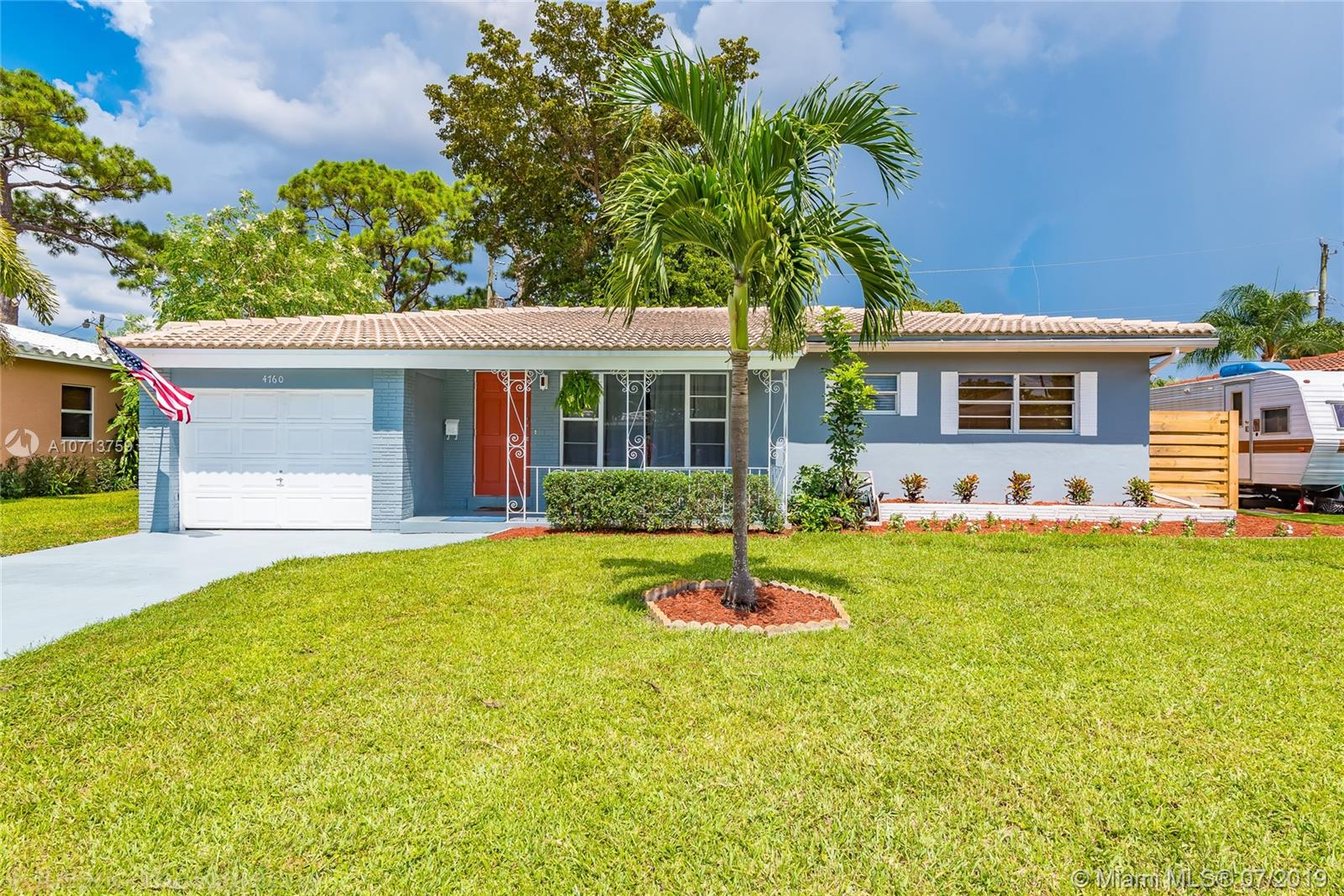 Beautiful home in the desired heart of Oakland Park. FEATURES: wood floors in all rooms & slate floors in the bathrooms and laundry room. Solid CBS construction with a beautiful barrel tile roof, a spacious screened in porch with a patio barbecue area, large fenced in yard with plenty of room for a large pool, and front porch with room for chairs and tables. Large laundry room with enough room for a full bathroom combination laundry room if desired. It has a huge oversized one car garage that could easily be converted into a large 3rd bedroom.The air conditioner was replaced end 2018, and was upgraded to a 3.5 ton unit. House was recently painted inside and out, and is tastefully landscaped. Don't miss this charming home in a great neighborhood!  12-2