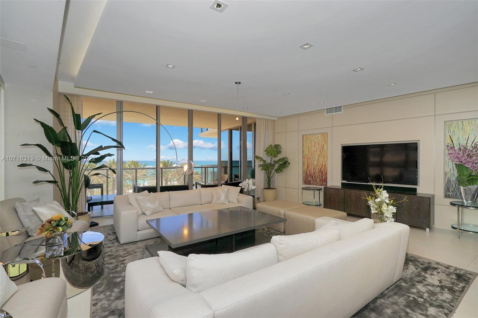 Developer's model unit - very stylish as designed by Steven G, spacious, corner, 4 bed/3.5 bath residence at the 5 Star St. Regis resort offers sweeping ocean, gardens, park and skyline views from soaring glass walls and extra deep terraces. Featuring a fully equipped chefs kitchen with wine storage & double ovens; generous living areas and separate media room, all steps from the famous Bal Harbour Shops. Bespoke living at its finest, St. Regis offers 24 hour concierge and room service, private oceanfront cabanas, separate residents amenities and full service spa.