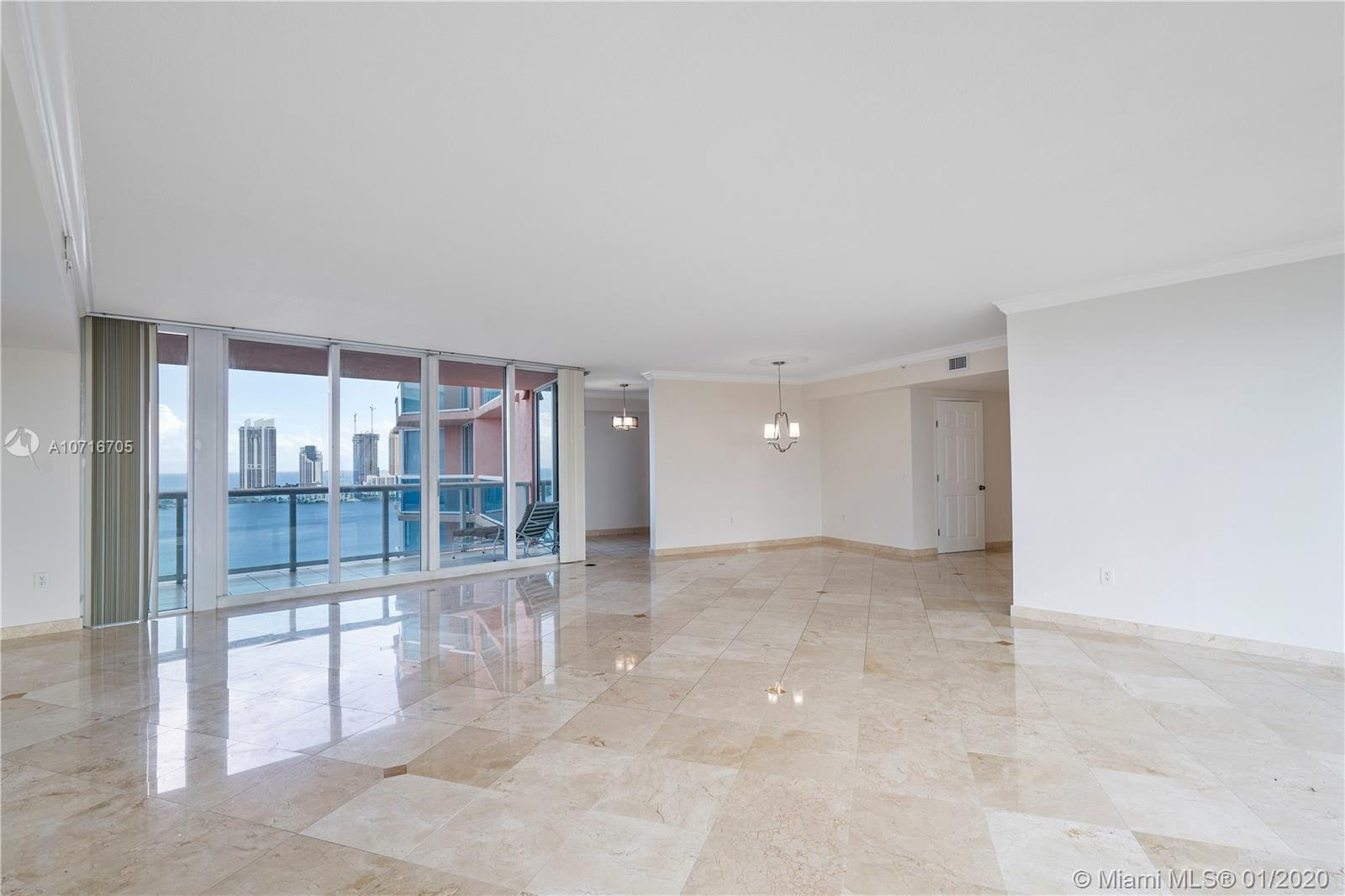 Enter from semi private elevator foyer to fabulous Hidden Bay Residence with wide open space. 2 sided glass flow thru offers stunning panoramic Intracoastal, Ocean + Golf Course views. 1,870 interior SF plan, wide oversized living room, 2 bedrooms + den or 3rd bedroom & 2.5 baths. Finest finishes include marble floors in living area, redone kitchen, 2 deeded parking spaces and storage. 24h guard gated acres with 5* amenities including New Lobby + Common areas, 2 story spa, gym, private 65 slip Marina, 4 tennis courts, valet, concierge + more.