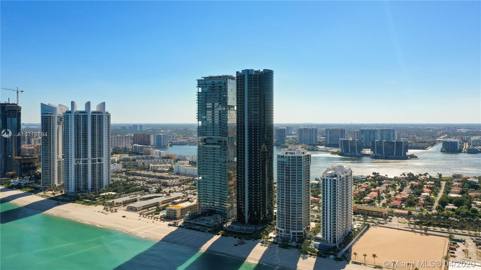 Last spectacular Duplex Ph unit available with best view in the building. Two story residence in Porsche Design Tower with 4 car garage, internal elevator, private pool, 2 balconies, 2 huge master bedrooms, sleek designer kitchen, EMPERADOR SPANIH MARBLE 48/48, unobstructed ocean and intracoastal views, private beach with sunset pool yoga center, state of the art gym, with simulator technology (VRX motion Z-55 racing), movie theater, restaurant and more!