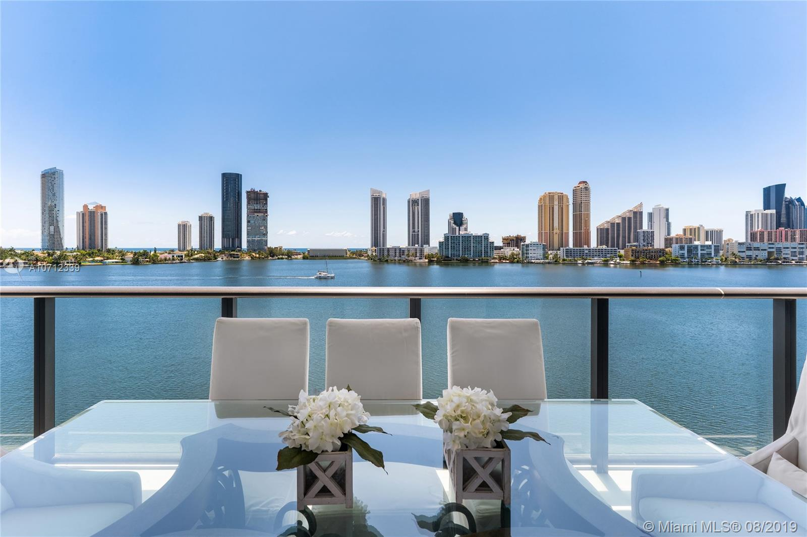 Bright and beautiful! 4 bedrooms and 5.5 bath residence with over 3400 SF. Of living area. Beautiful flooring and lighting details throughout, custom closets and doors, and exquisite designer furnishings. Incredible building amenities include marina, tennis, private beach, billiards, teen and children's room, restaurant, bar and spa. Please call us for additional details! Unit can be available with an additional turnkey suite which includes it's own bedroom, kitchen and bathroom; with beautiful water views. Price upon request.