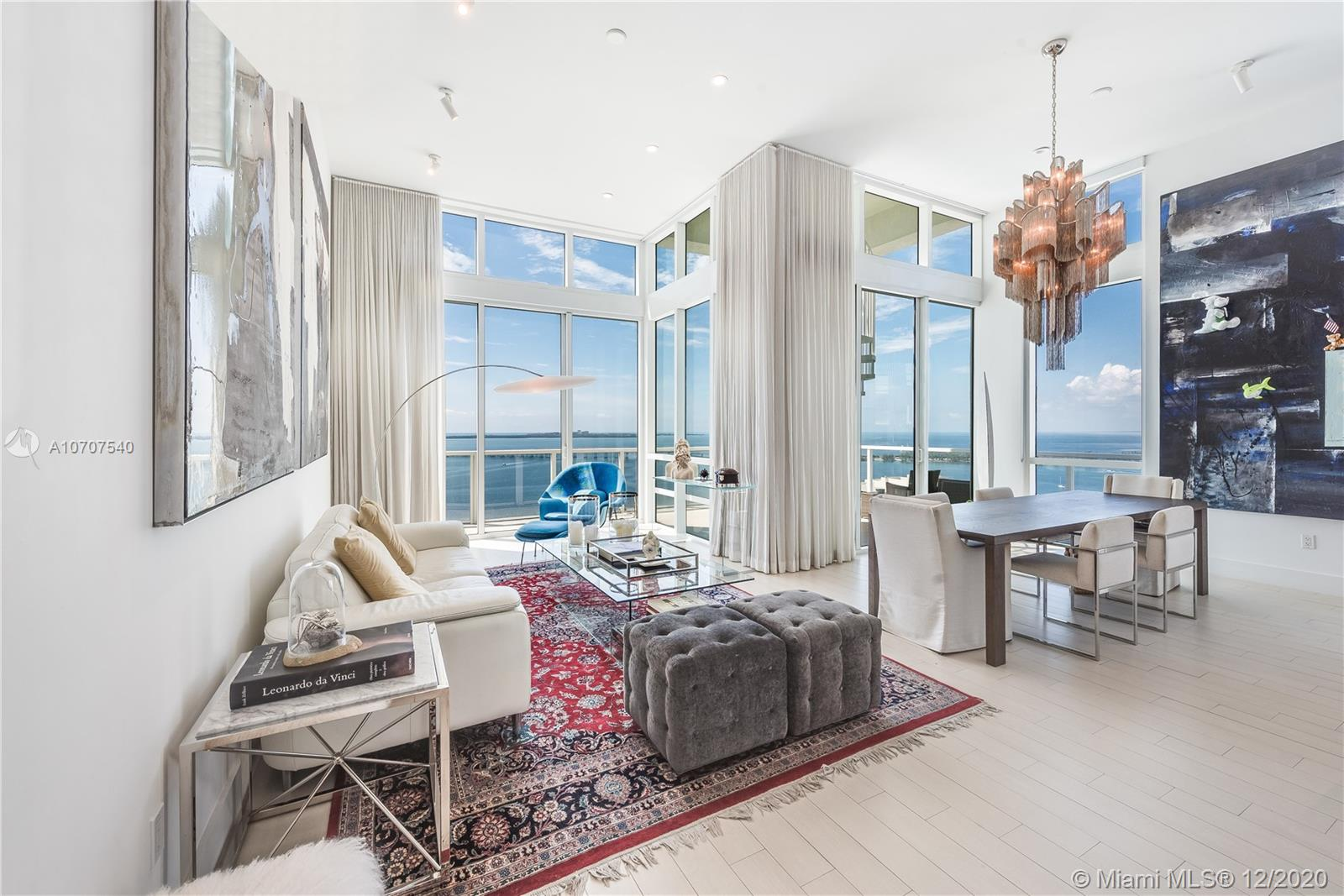 Stunning unobstructed views of Biscayne Bay and Key Biscayne from this custom 3 Bed/3.5 bath penthouse with a private roof top terrace. This property features high ceilings, floor to ceiling sliding glass doors, marble floors throughout, upgraded European kitchen with cooking island and subzero refrigerator, spacious master suite, and walk-in closets. The building offers 24-hour concierge/security service, a rooftop infinity pool, gym and spa with awe-inspiring views of the ocean.