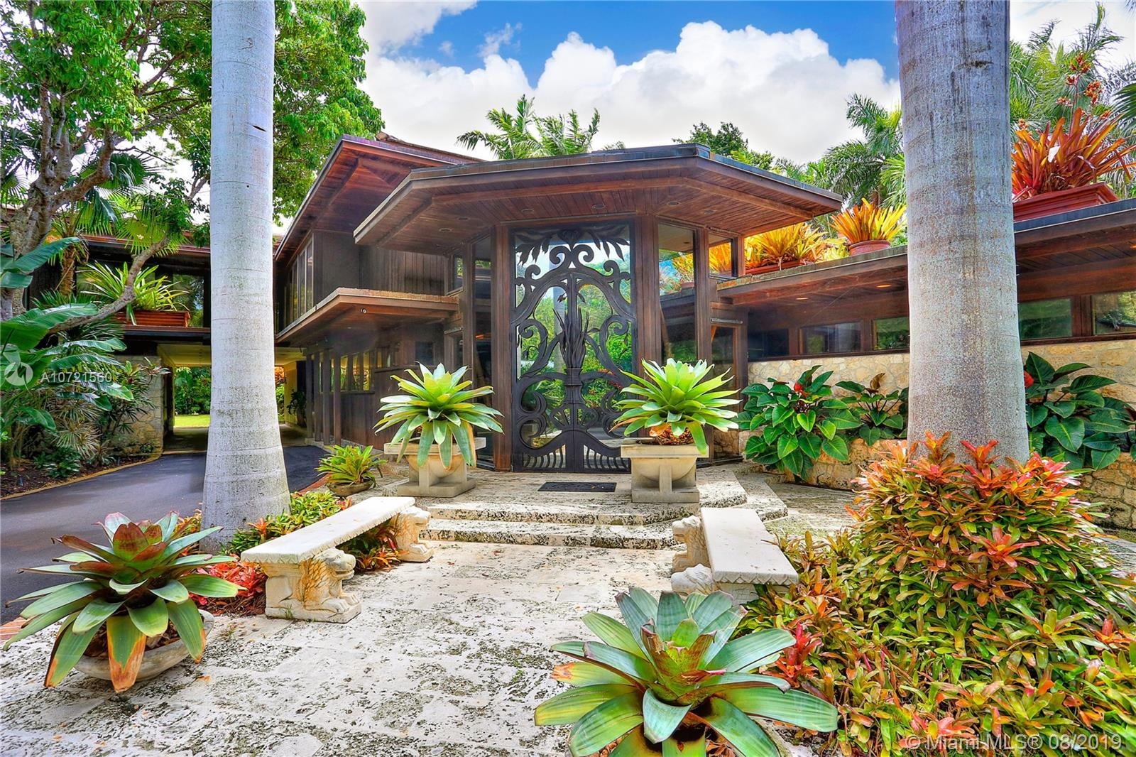 Prepare to be enchanted as you enter this stunning mid century modern estate, designed by famed architect Alfred Browning Parker. Sited on over an acre, this amazing property is a feast for the eyes and includes sprawling green lawns, sparkling fish lagoons, fountains, a separate guest cottage and lavish pool area. This idyllic tribute to one of Miami's most iconic designers of unforgettable properties has it all!! Significantly expanded and renovated by the current owners with great care in maintaining the integrity of the original design and employing the highest quality materials and workmanship; impact windows, modern kitchen and bathrooms, large and impressive art walls. Enjoy 6 bedrooms, 5.5 baths amid one of Miami's prettiest garden settings in the prime Ponce-Davis area.