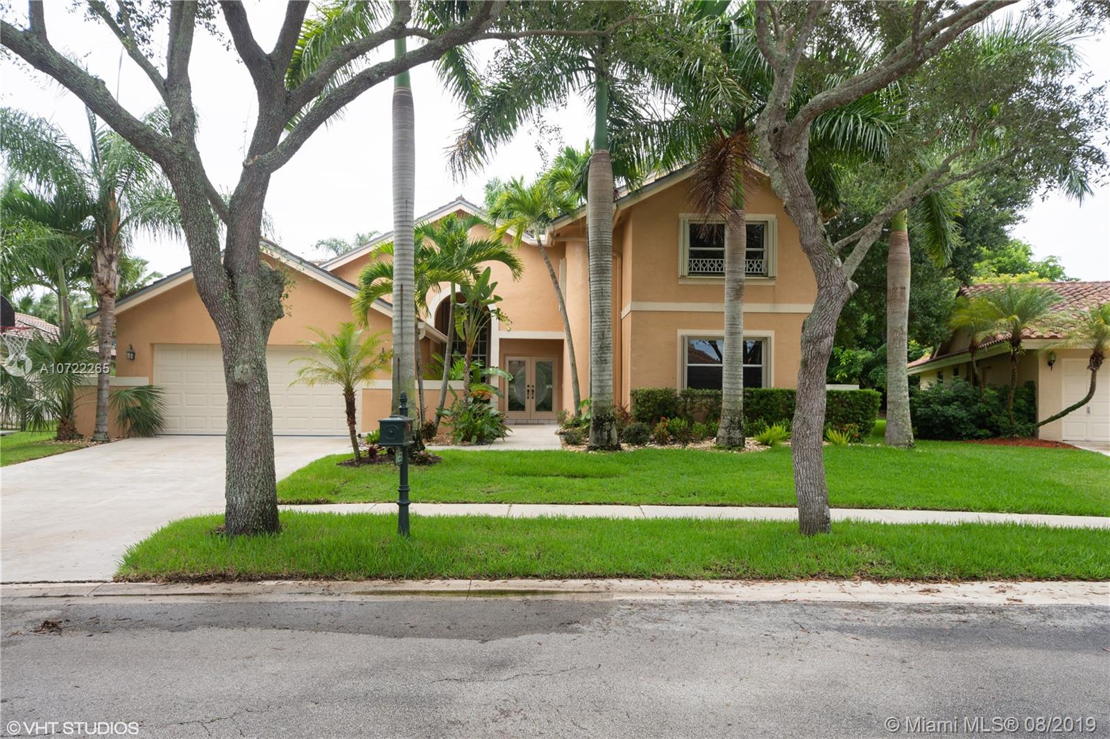 """2 story home: 5 bedrooms, 3 bathrooms, over 3,000 sqft! Fenced back yard features 36 foot pool & lake view. Walk to town center: shops, grocery, restaurants & parks. """"A"""" rated schools: walk to elementary & middle; zoned for Cypress Bay H.S. Vaulted smooth-texture ceilings, updated lighting & new paint. Kitchen has cherry cabinets, granite, & stainless steel appliances. Large master suite: 2 walk-in closets & pool access. Laundry room with food pantry"""