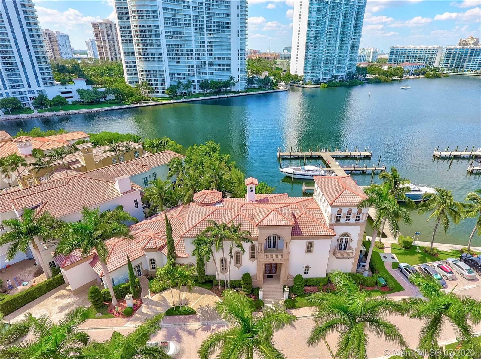 AVENTURA MOST EXCLUSIVE WATERFRONT VILLA IN THE PRESTIGIOUS, PRIVATE GATED COMMUNITY OF ISLAND ESTATES. CELEBRATED OPULENCE & TIMELESS LUXURY IN THIS MEDITERRANEAN MANSION WITH 6 BR/8.5 BA, OVER 7,300SQFT  WATER VIEWS, PRIVATE MARINA. GREAT FOR ENTERTAINMENT OPEN FLOOR PLAN, HIGH CEILINGS,  ELEVATOR, DUAL HUGE MASTER BEDROOMS, WINE ROOM, WET BAR, FIREPLACE, STEAM SHOWER, HEATED POOL/SPA, GOURMET & OUTDOOR KITCHEN, 2 STORY FOYER, OUTDOOR TERRACE, 50' BOAT SLIP INCLUDED DEEDED DOCK. A TRUE OASIS, LIVE ON YOUR OWN PRIVATE ISLAND . ENJOY THE AMENITIES OF PRIVE FIVE START RESORT, TENNIS COURTS, SPA, INDOOR LAP POOL, HAIR SALON, 3 RESTAURANTS, CIGAR LOUNGE, MARINA FOR YACHTS, KIDS PLAYGROUND, DOGGIES HILL PLAY AREA, WALKING/RUNNING TRAIL & MUCH MORE!!