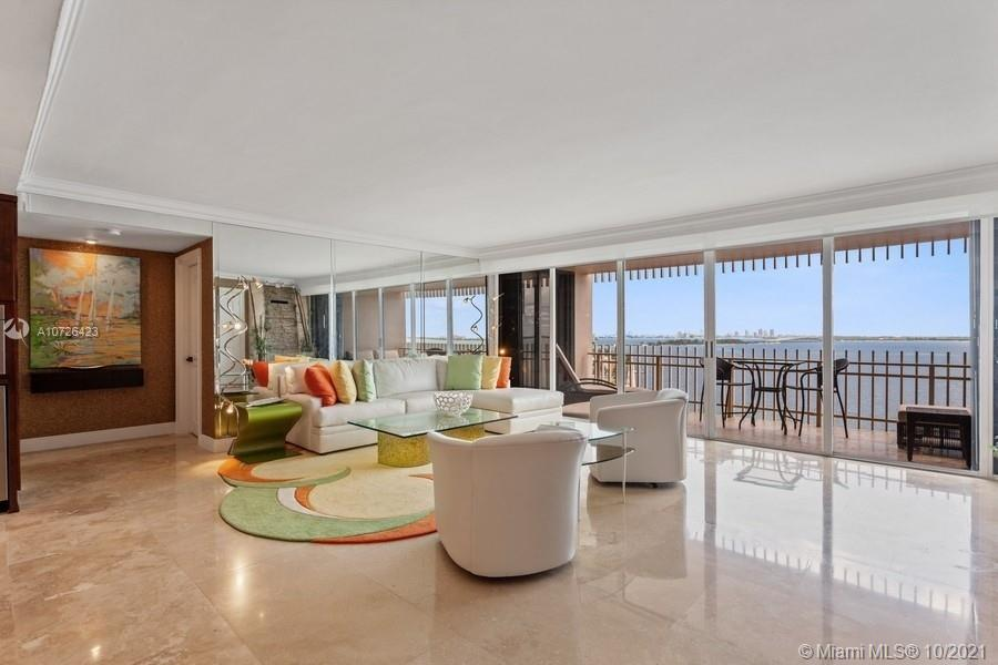 """Finally....A high floor, renovated, large, 2 bedroom, 2 bathroom popular """"split plan"""" is now available! Enjoy incredible views during the day and at night of the open bay and downtown Miami skyline. This residence offers marble floors in main living areas, crown moldings and baseboards, lots of built-in storage cabinets, recessed lighting, a custom built-in fountain and an open kitchen with high-end stainless-steel appliances. The split floor plan creates space and privacy between both bedrooms while the open layout and custom built-in bar area is great for entertaining. Both bedrooms are spacious and have fully renovated on-suite marble bathrooms with long extended marble showers, double sinks and granite/marble countertops."""