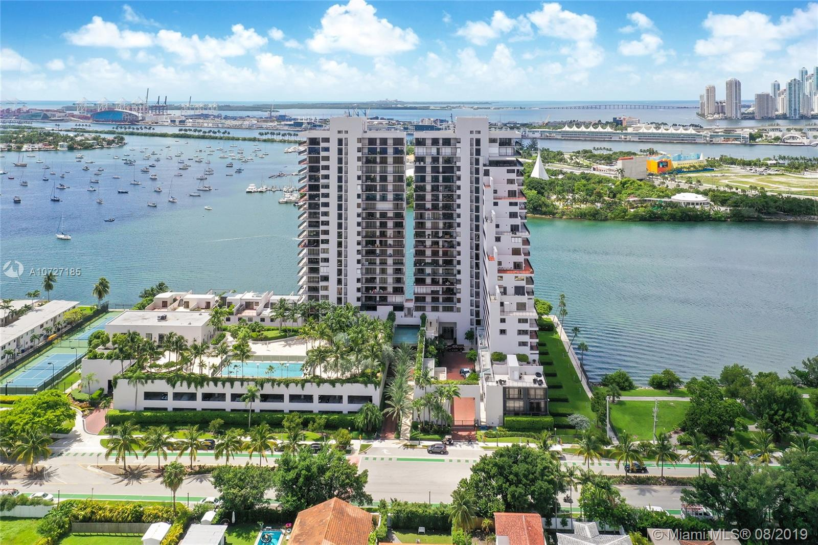 KILLER VIEWS! Stand-alone building on prime waterfront with unobstructed views as far as the eye can see. A daily treat to have full panoramic views of Downtown Miami, Atlantic Ocean, Biscayne Bay, Cruise Ships, and all Venetian Islands. Spectacular sunsets are the perfect ending to the day. And, nighttime sky line views will take your breath away. Light and bright flow through unit is impeccably maintained with floor-to ceiling glass. Easily entertain with the use of two XL balcony's providing different vantage points for views and access from living spaces, kitchen, and bedrooms.Amenities with fitness center, 2 pools, 2 lighted tennis courts, childrens play area, BBQ area, 24 hr security, and more. Building has undergone extensive renovations. Seller has paid ALL assessments in full!