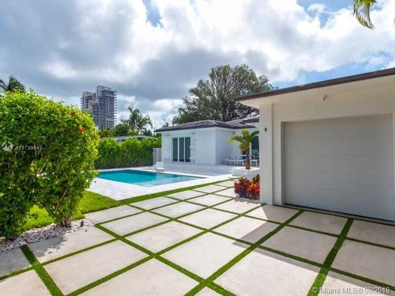 Beautiful remodeled home in exclusive Venetian Isles. Very beautiful home with lots of privacy.