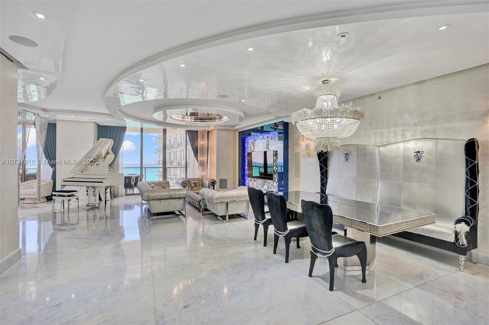 Gorgeous spacious unit with direct ocean and city views, 3 bdr + DEN/3.5bth in St Regis, Bal Harbour. Rare floor plan 05 and 04 combined by the developer - very spacious and large unit! Unit features sleek floors, pearlescent venetian stucco throughout, drop ceilings, customized lighting, high-tech built-in appliances. Enjoy the ocean and bay/city skyline views. Every room in a unit was designed to perfection by famous designer Roberto Cavalli and was also beautifully furnished with Visionnaire Furniture, created by Cavalli Family. Living at its finest, St. Regis offers 5-Star resort amenities with a 24 hour concierge and room service, private oceanfront cabanas, separate residents amenities, full service spa, 4 pools, three restaurants and more.