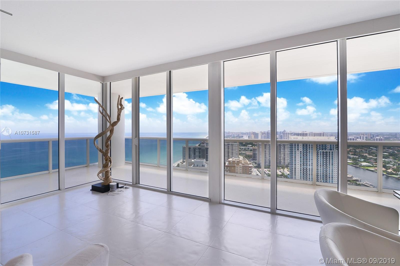 This stunning rarely available southside corner unit offers 270 degree views with direct ocean, intracoastal & coastline views  to South Beach. Owner spared no expense, upgraded bright spacious unit with state of the art kitchen, newer appliances, custom closets, 2 bed/2 full bath plus additional den created to be used as guest suite or office. Enjoy sunrise and sunsets from your two private large balconies. Updated bathrooms with newer vanities. LG washer & dryer. Beach Club complex offers 5 star amenities, multiple pools, 2-story fitness center, 24 hr valet, security, private beach access. Close to restaurants, shopping, airports, casinos and all major attractions.