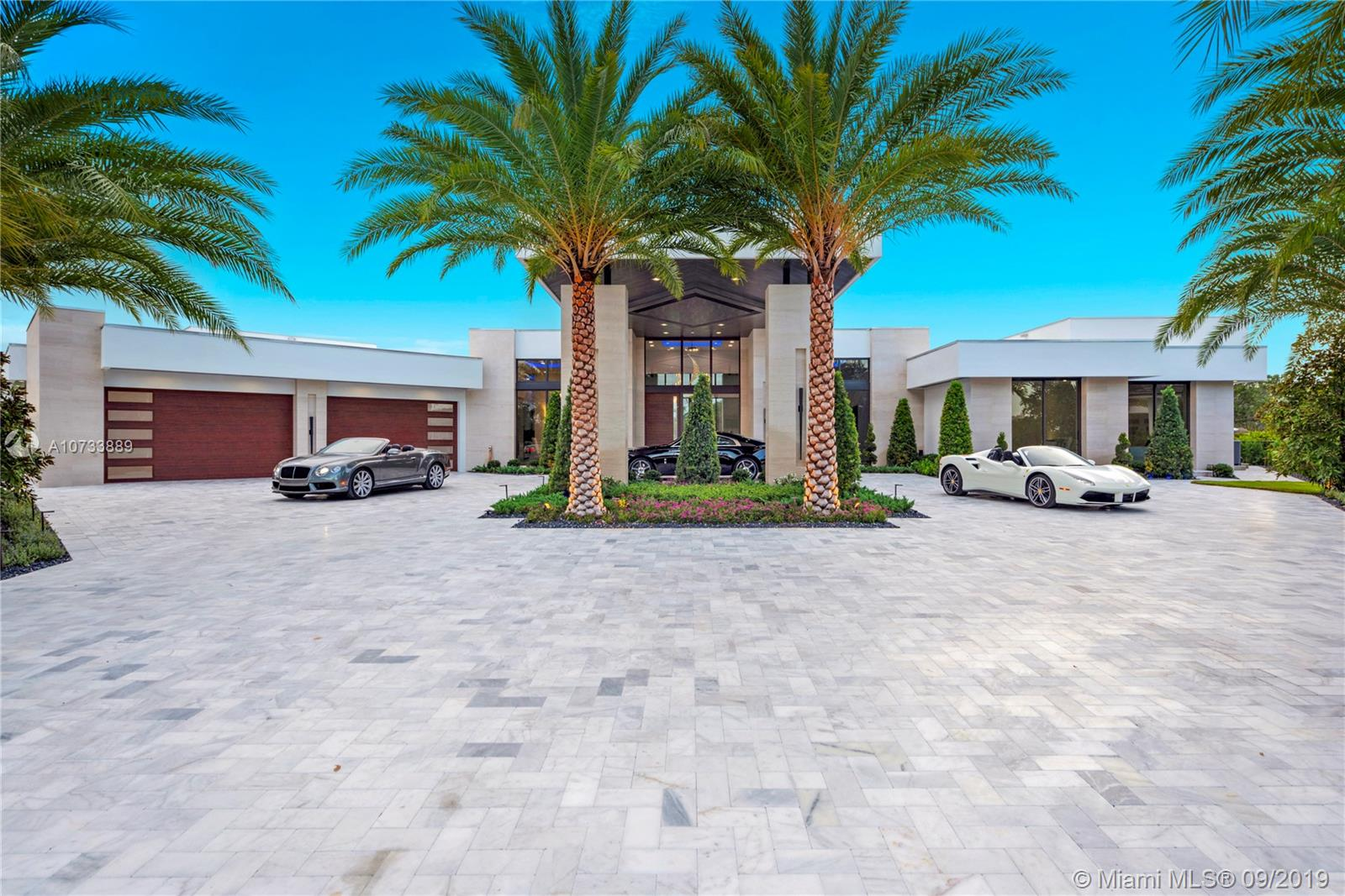 "One of a kind designer home located in the newest & most exclusive gated community in Fort Lauderdale; The Enclave at Coral Ridge Country Club -  6 Bedroom | 6.5 Bathroom | 5 Car A/C Garage |Plus a Media/Club room | 10,629 SQFT Covered | 26,580 sqft over sized corner lot. Come home to your glass showroom garage or enter under your towering Porte Cochere. Sprawling master suite with attached bonus room and breathtaking spa inspired bathroom with 19' ceilings. Resort style pool, summer kitchen and 20' water curtain transforms your outdoor space into a tropical oasis. Other features include; 12' glass sliding doors, 2300 Sqft. covered patio area, smart home by ""Savant Pro"" home automation, Master Chef kitchen with 15' island, 3 fireplaces, 500 bottle glass wine storage, plus much more"