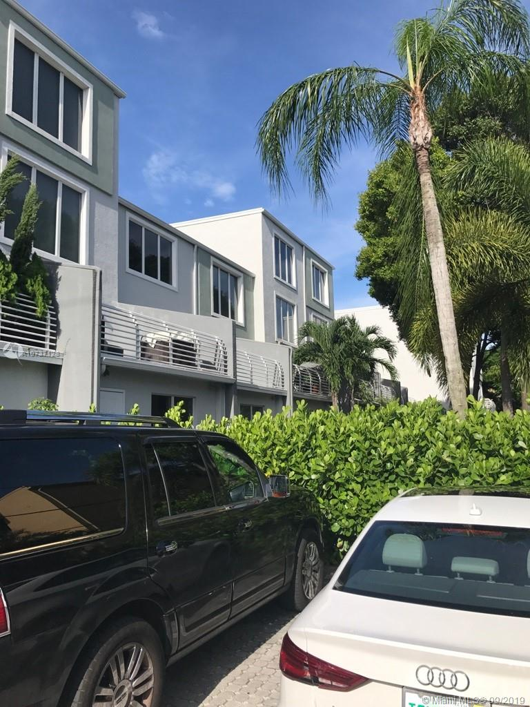 Price Reduction!!! Largest unit at the Lofts of Wilton Manors.  3 bedrooms, 3.5 baths.  This is a 4 story unit with a full bedroom and bath on the first floor, a full bedroom and bath on the 3rd floor and a full bedroom and bath on the 4th floor.  The living room, dining area and kitchen, laundry room and half bath are all on the second floor.  This is an open floor plan with view of your own private garden from every room.  The second floor has a large balcony overlooking the garden with plenty of room for outdoor furniture, bbq and hot tub.  This is the perfect unit for someone looking to live and play in the Wilton Manors/Fort Lauderdale area.  Have your own flower or vegetable garden right outside your door.