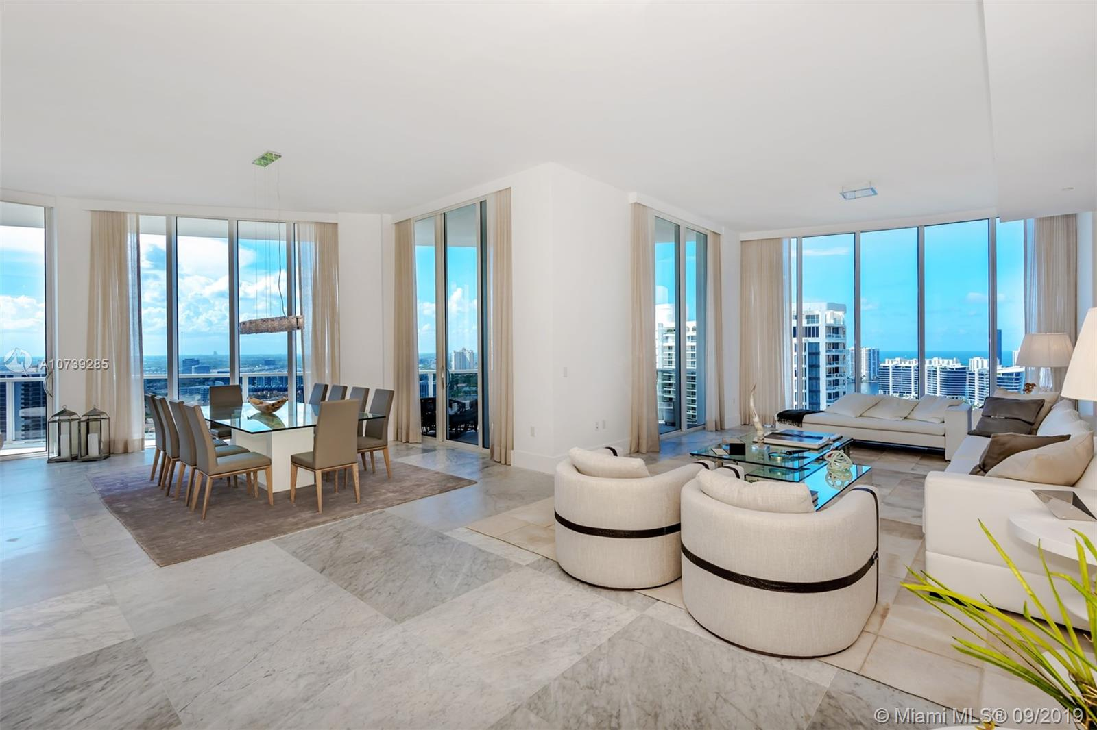 Turn-key Unique Sky Home at Bellini Williams Island Type of property that it sells for itself. Make sure you see my UNBRANDED AMAZING 3D VIRTUAL TOUR ATTACHED +6,000 Square Feet Outstanding master room with his and hers own bath and walking closets, beautiful marble flooring throughout, 180 degrees of balconies and panoramic views. Maid's room, 4 Beds, 6.5 baths, 12 Ft Ceilings its own foyer and private elevator. Endless amenities with State of the Art Spa, two Restaurants, twelve tennis courts, ETC....