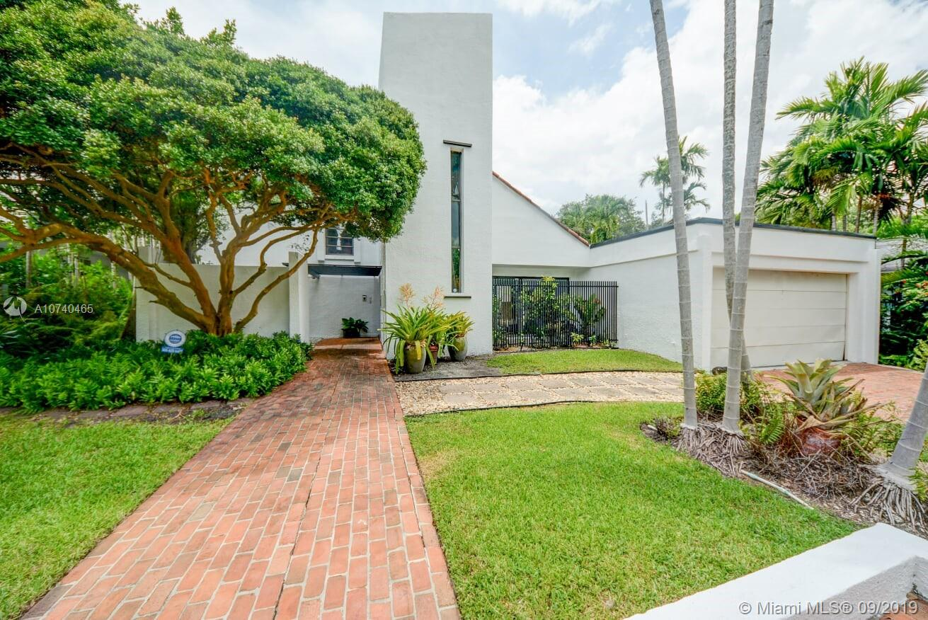 First time on the market since built in 1972; this beautiful modern architecture two story home was certainly ahead of its time.  It features 4 beds/2.5 baht open floor plan with pool.  It's a not to miss opportunity in the exclusive neighborhood of Bay Heights in Coconut Grove. Great curb appeal, spacious upgrade kitchen, two car garage, lot of natural lights, 24/7 police patrolled community, walking distance to Brickell and Key Biscayne. Easy to show; call for a private showing.