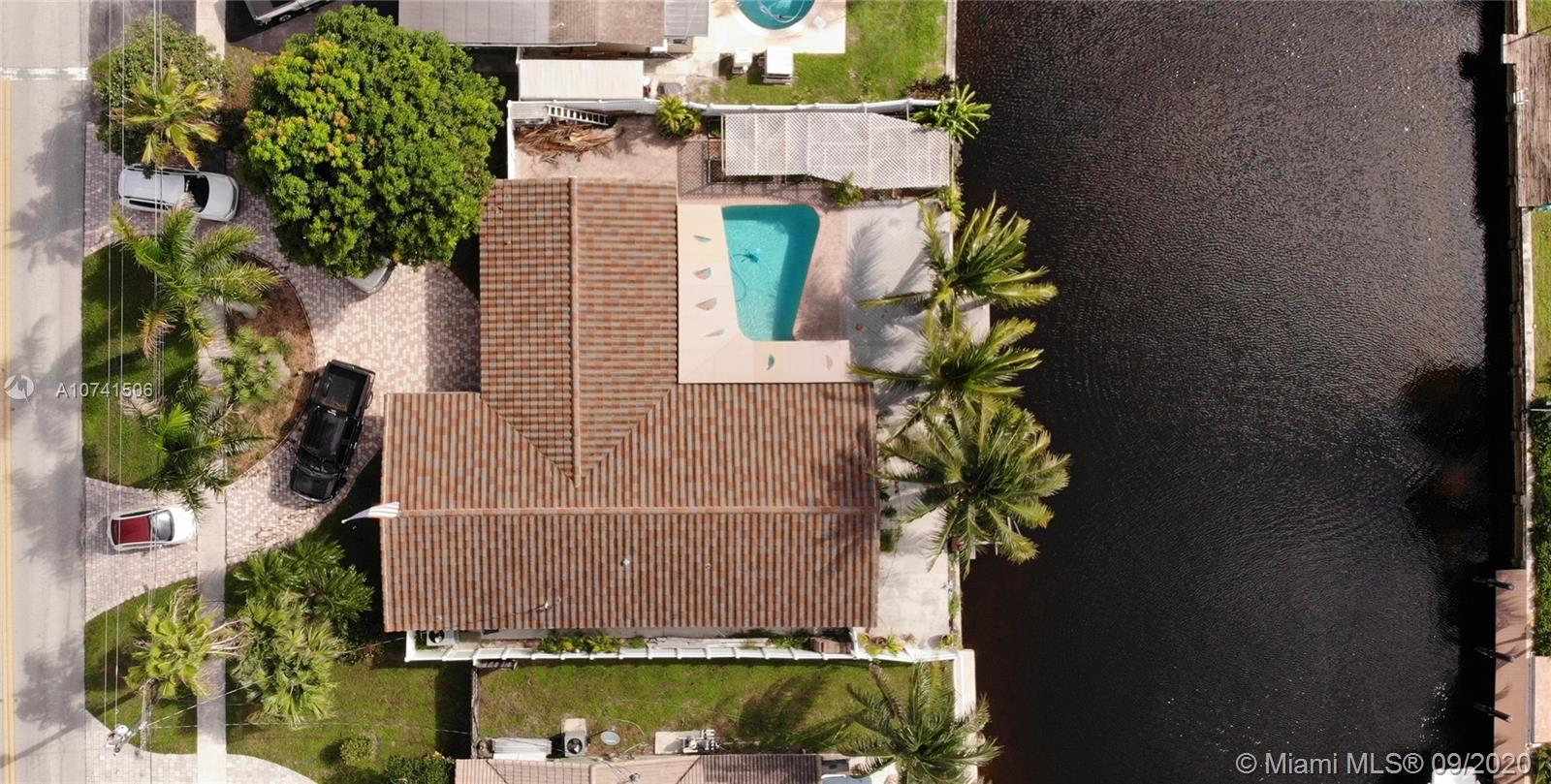 NEW AC 6/2020! Make this your home. Walk to Pine Crest school. Tile roof is approx 6 yrs old & stucco soffit, LED lighting around entire home. Wired for generator, impact doors & some windows, clear hurricane panels for others.  Enjoy ocean access waterfront w/private dock & boat lift. Relax in your salt water pool. Tankless water heater. Travertine flooring in living areas/kitchen. Kitchen has a great island w/soft close drawers, granite, ss appliances, lots of cabinet space. Master bath redone w/Turkish marble & glass enclosed shower. 2nd bath features jacuzzi tub & separate shower. Custom awnings, garden area for the green thumb. Enjoy coconuts & sweet mangos from your own trees. 1 car garage for your toys/car/storage. Mins from I95 & US1 for easy commute. https://youtu.be/kNDRT8K3QUI