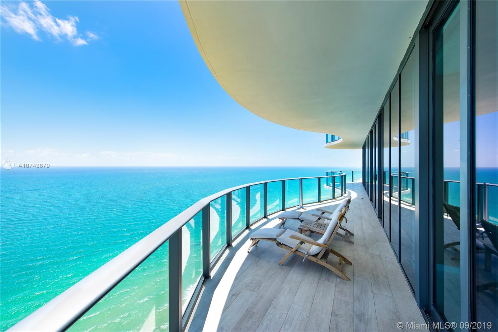 Enjoy dramatic 360º endless views on your wrap-around 2100 SF terrace; from the ocean blue to the multi-million-dollar homes of Golden Beach and the downtown Miami skyline over Biscayne Bay. Top of the line SubZero refrigeration and Italian cabinetry grace your private chef's kitchen complete with built in wine storage and an outdoor BBQ. Kreon lighting, Crestron home automation, electric blinds and surrounded by polarized thermal windows panes. Masterfully designed by Architectonica and interior design by Charles Allem, as an extension of your private residence, Regalia offers a concierge, full service spa, beach & pool, a private wine vault, business center, children's play room, library, yoga studio and fitness center featuring state of the art Technogym, Cybex and Peloton equipment.